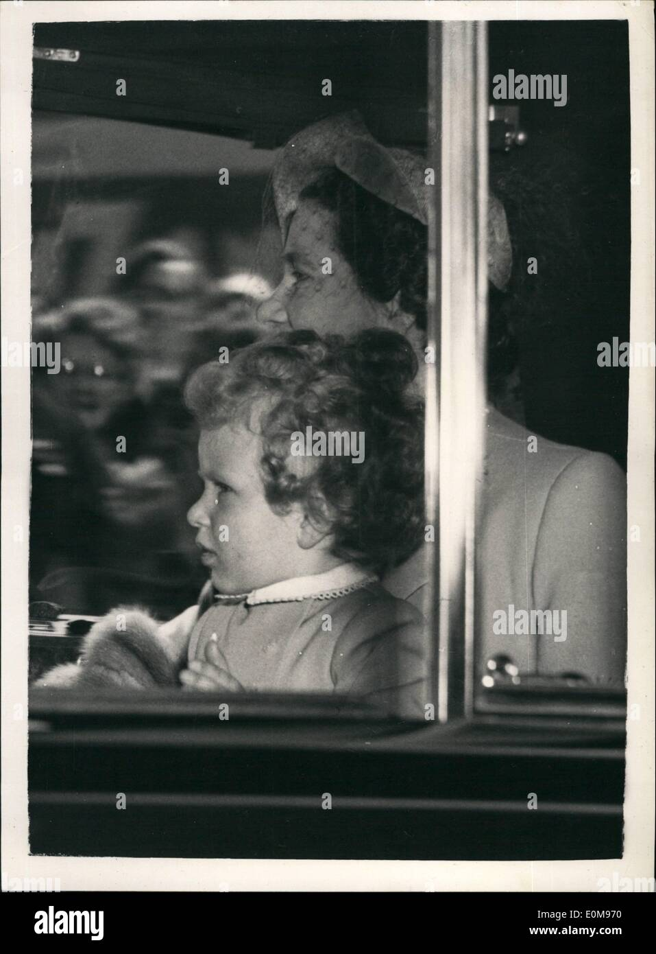 Apr. 04, 1954 - The Royal Children at Waterloo, Princess Anne with the Queen Mother; Photo Shows Princess Anne seated on the lap of the Queen Mother when she arrived at Waterloo Station this afternoon with her brother Prince Charles and Princess Margaret. They are traveling to Portsmouth where the children will board the Royal Yacht Britannia for Tobruk to meet their parents the Queen and the Duke of Edinburg. - Stock Image