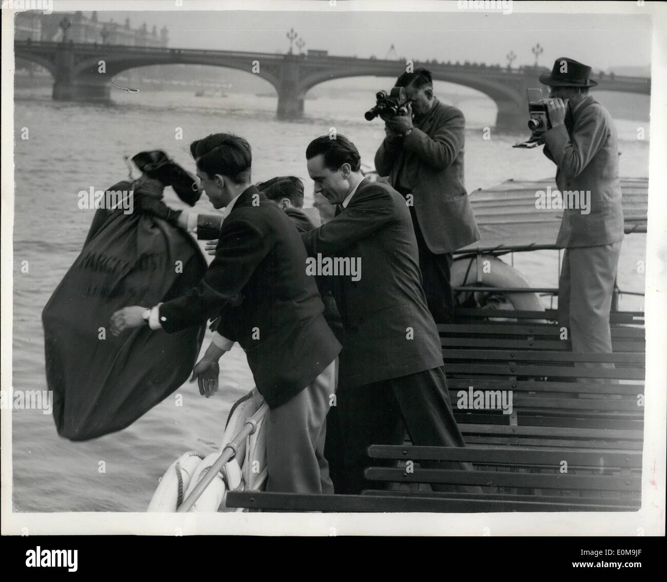 Apr. 04, 1954 - Sally Was Very Worried - But Nick Made It.... ''Escape'' In River Thames: Nick Jansen went to the River Thames by Westminster Bridge during thr week-end to demonstrate his prowess in escaping.. He allowed his assistants to handcuff him - put him in a mailbag and drop him in the River.. Sally Chinnon his finances was very worried - until Nick popped up - free - at last.. Keystone Photo Shows:- Over the side goes Nick Jansen - in his tied up mailbag.. It was not very long before her turned up again - a free man. - Stock Image