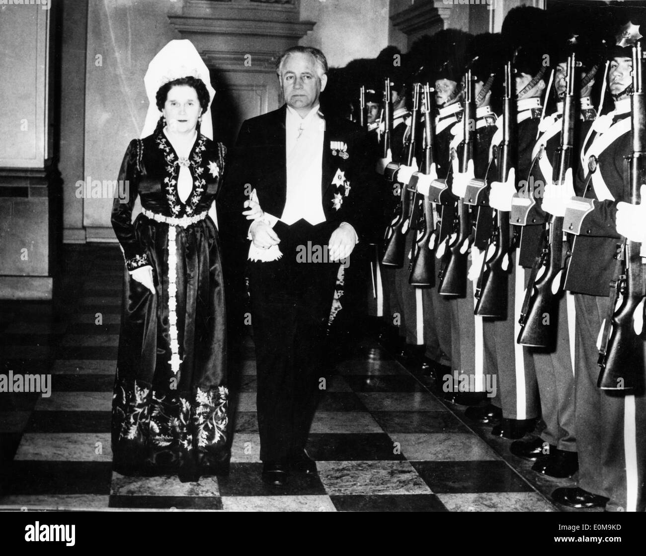Apr 06, 1954; Copenhagen, Denmark; President ASGEIR ASGEIRSSON of Iceland, accompanied by his wife, arrived in Copenhagen yesterday on an official visit to Denmark. This is the Icelandic President's first visit to the Danish capital, which for 500 years was also the capital of Iceland. Last night they attended a dinner given by King Frederik in their honour, at the Knights' Hall, in the Christiansborg Palace, Copenhagen. The picture shows President Asgeir and his wife arriving at the Christiansborg Palace. - Stock Image