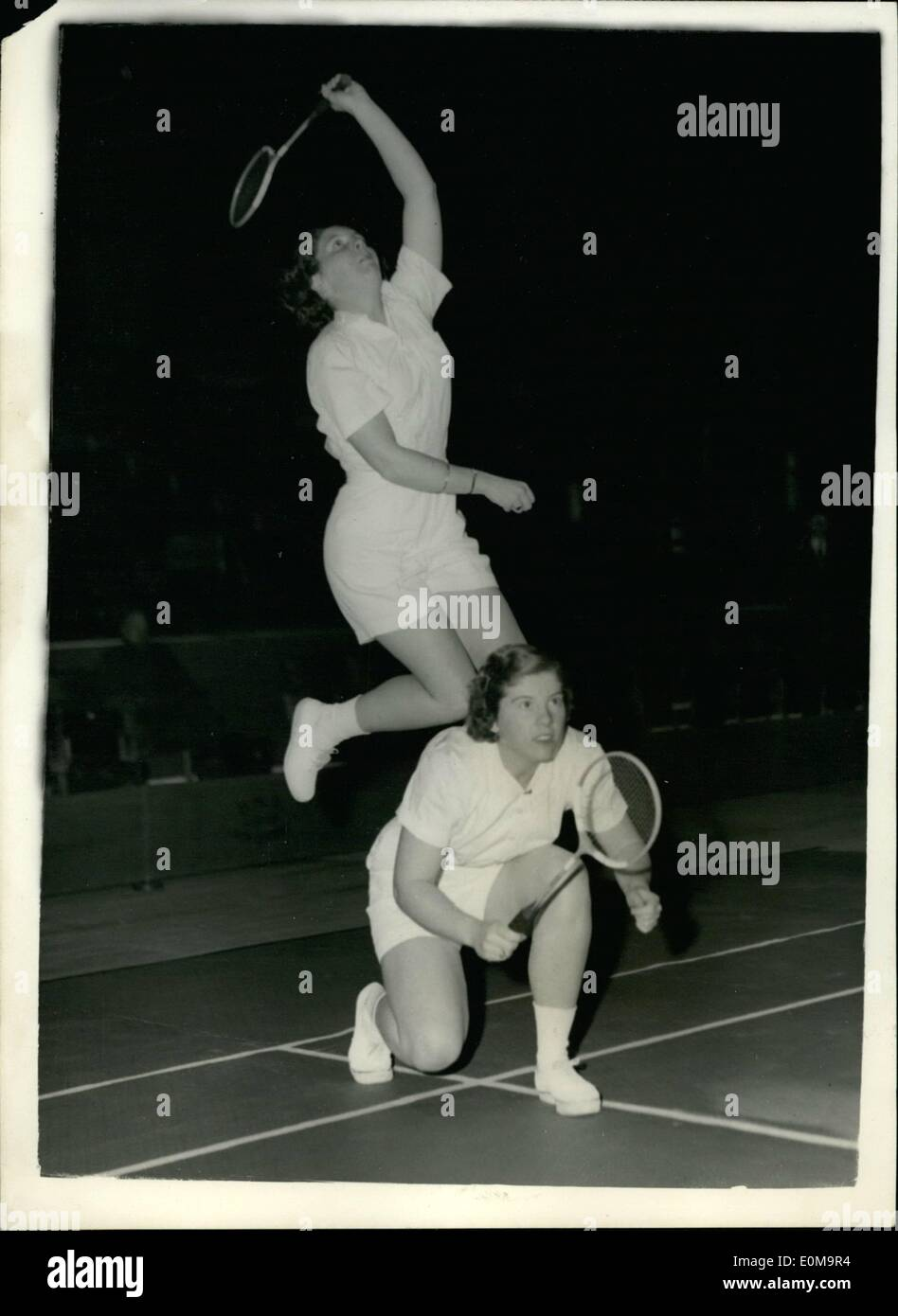 Mar. 03, 1954 - Opening of the All England Badminton Championships. The Devlin sisters from America. Keystone Photo Shows: American sisters who partner each other in the doubles events seen at Empress Hall this afternoon in the All England Badminton Championships. They are Judy Devlin (22) who crouches as her sister Susan (18) reaches high. JSS/Keystone - Stock Image