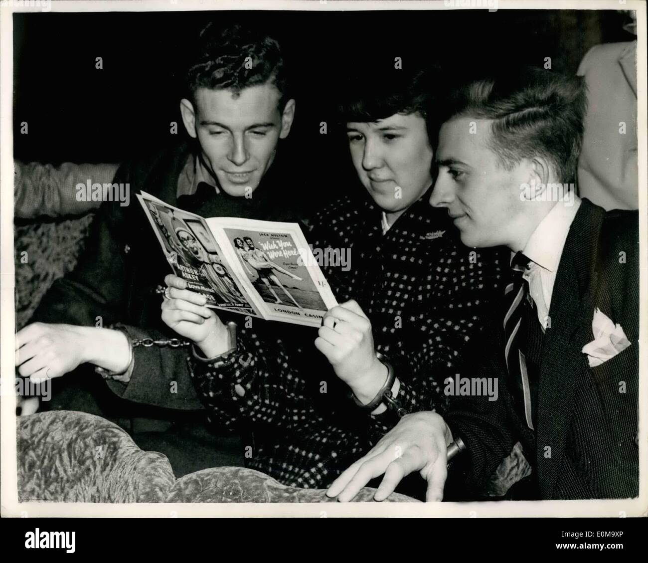 Apr. 20, 1954 - 20-4-54 The girl who must be handcuffed to her two boyfriends for a week. To enable Jill Johnson, of Eltham to win a prize in the Radio Luxemburg programme People are Funny she must decide in one week which of her two boyfriends, 20-year-old John Bingley and 20-year-old Eric Ward, both from Muswell Hill, and at present home on leave from the R.A.F. she will settle down with. To help her decide she must go around with both of them each evening handcuffed to her, and from this unpleasant experience she must choose the one she thinks is most likely to make the best husband - Stock Image
