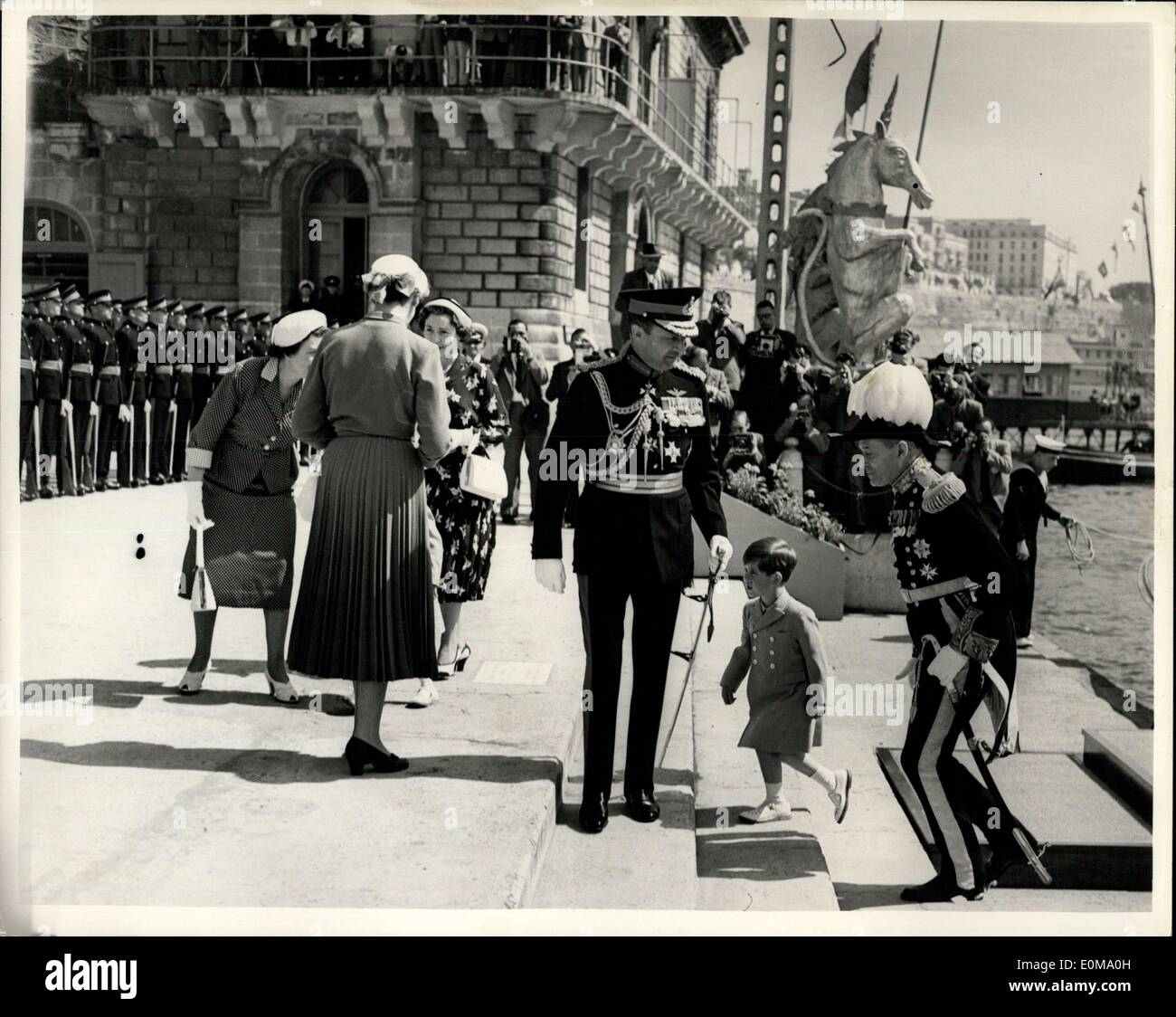 May 04, 1954 - Prince Charles And Princess Anne Watch Malta Parade. Photo shows Prince -Charles is escorted ashore at Custom House Quay, Malta, today, by Sir Geraldcreasy (right), the governor of Malta. With Princess Anne, the little Prince was on his way to watch the Queen and the Duke of Edinburgh review a combined Services - parade on the Floriana parade ground, which the Royal children watched from a hotel balcony. - Stock Image