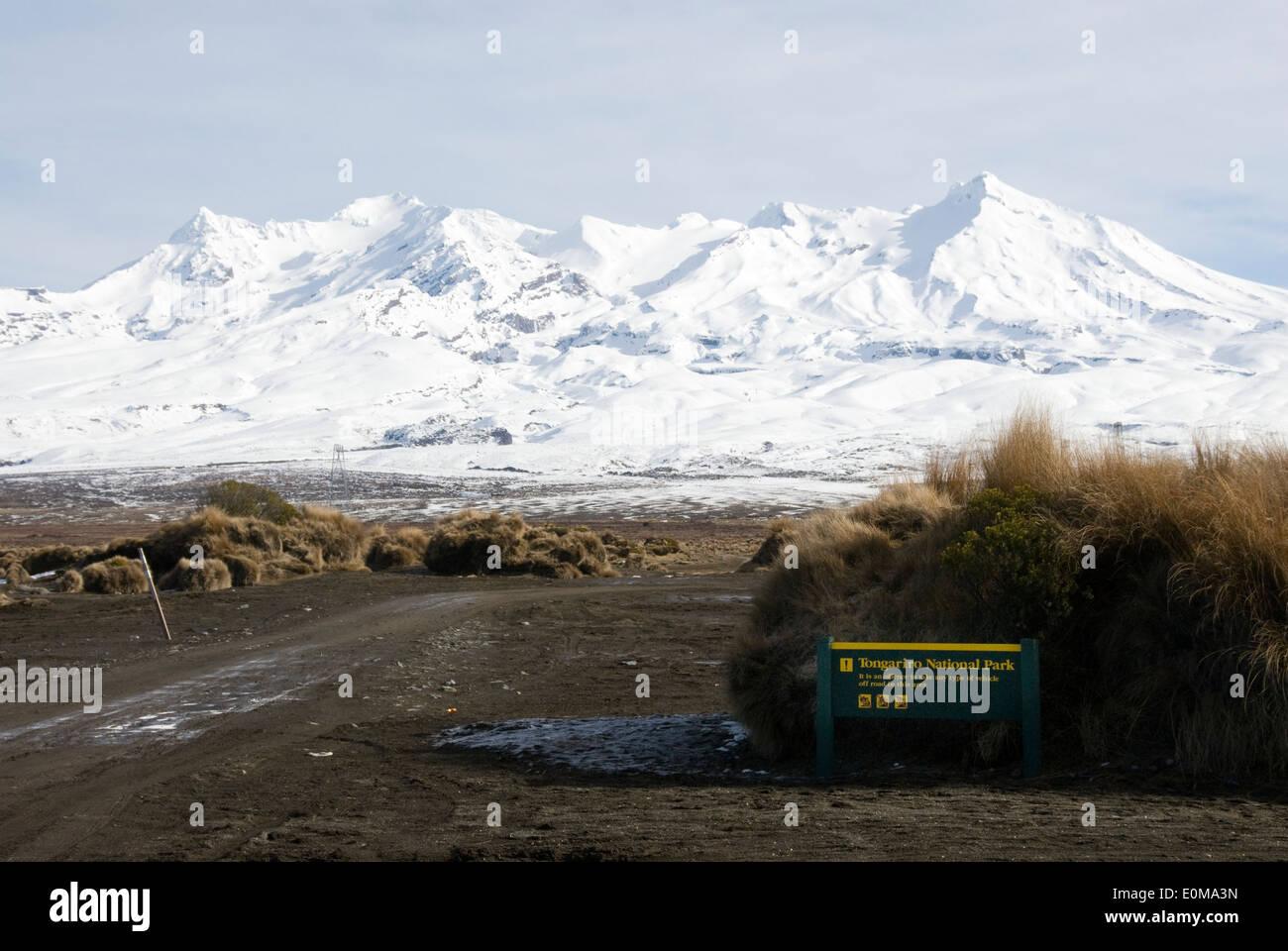 Track and DOC sign, Rangipo Desert, Desert Road, Mount Ruapehu, Tongariro National Park, North Island, New Zealand - Stock Image