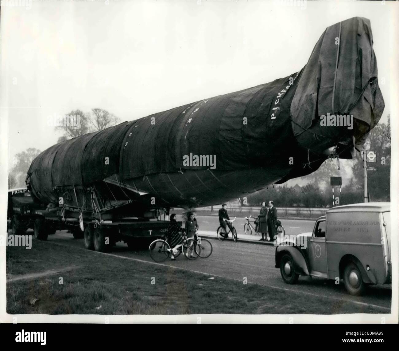 May 05, 1954 - The comet fuselage looks like a whale : looking very like a whale - is this fuselage of a B.O.A.C. Comet aircraft - on its way to the royal aircraft establishment at farnborough for special tests it is seen in western avenue, northolt. - Stock Image