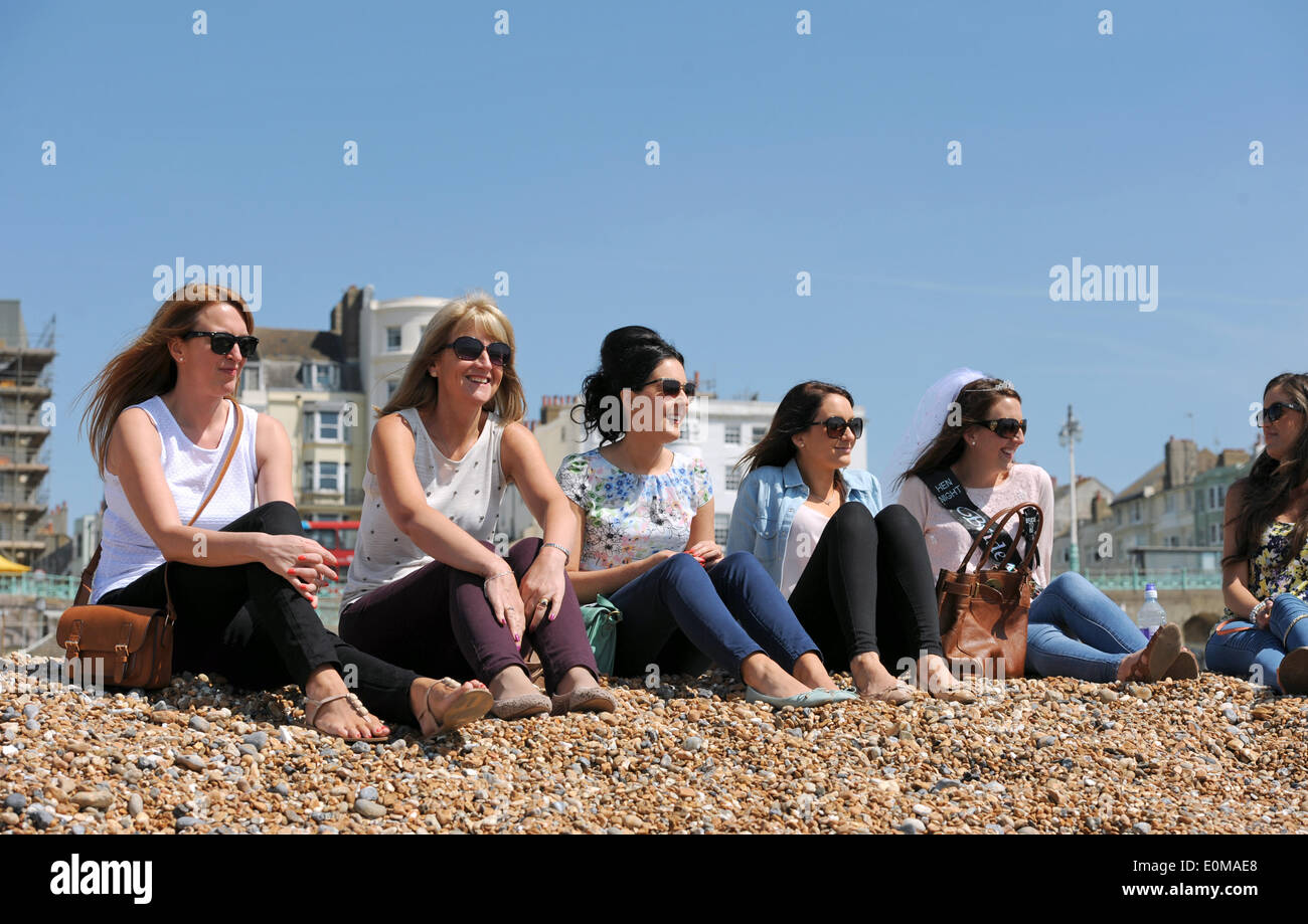A group of women on a hen party enjoy the hot weather on Brighton ...