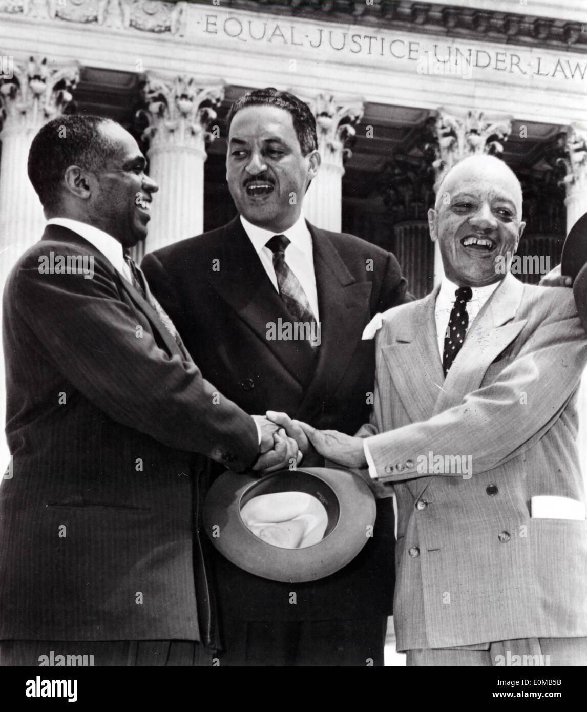 May 17, 1954 - Washington , District of Columbia, U.S. - Half a century after the historic ruling in Brown v. Board of Education that overturned segregated education, the US is marking 50 years of racial school integration. In 1954, THURGOOD MARSHALL (C) and fellow attorneys GEORGE E.C.HAYES (L) and JAMES M. NABRIT rejoice outside the Supreme Court after the winning decision ruling out school segregation in Brown vs. Board of Education. - Stock Image