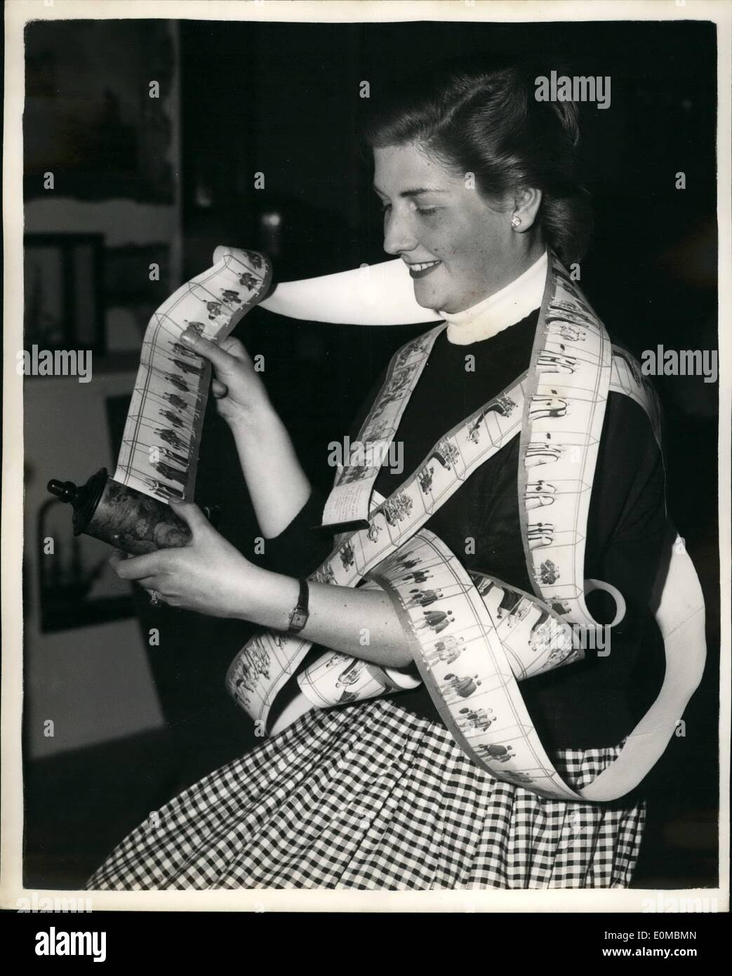 Jun. 06, 1954 - Antique dealers fair and exhibition at Grosvenor house. Photo shows Miss Margaret Leyland , of Croydon examines - Stock Image