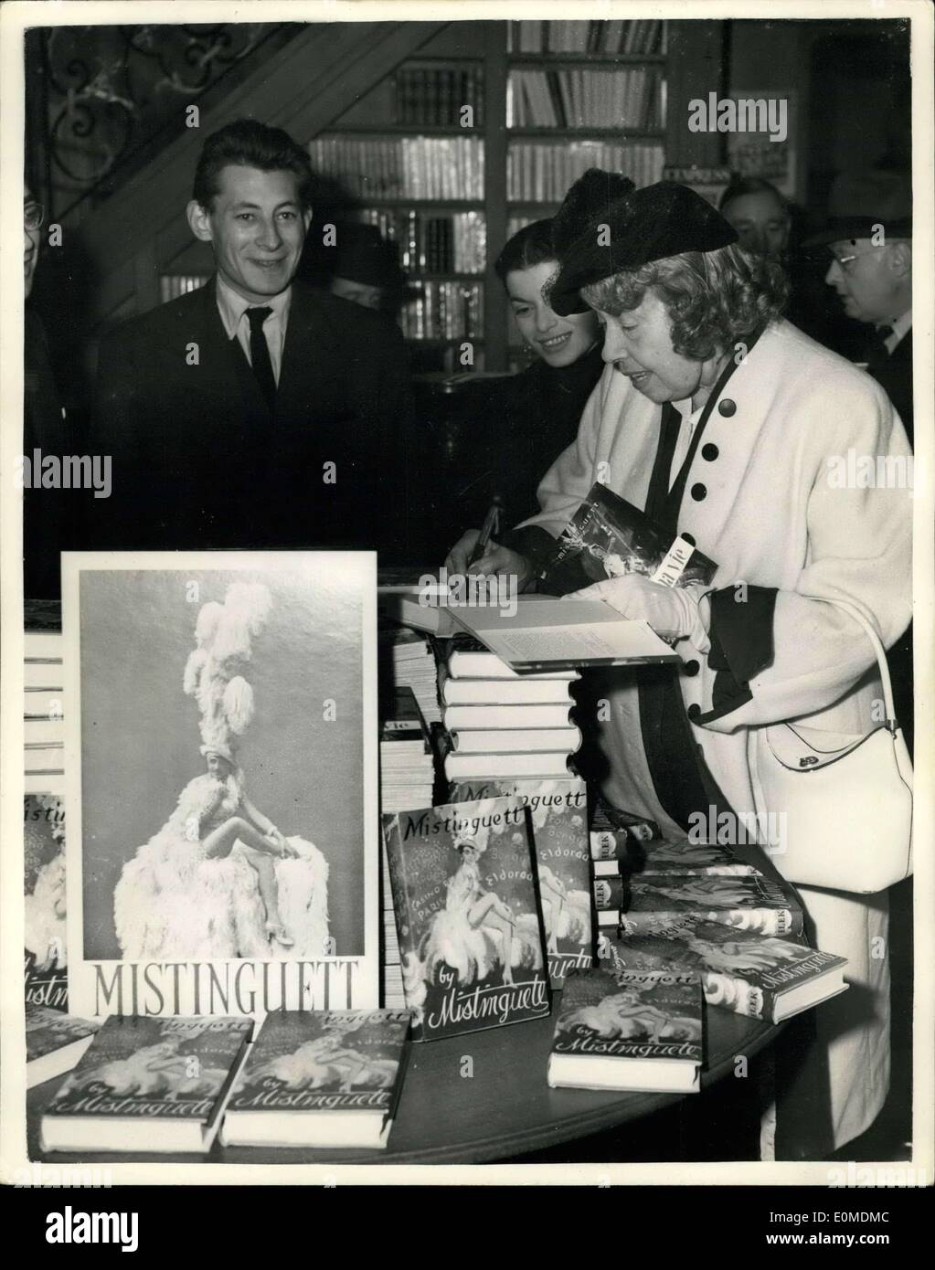 Oct. 11, 1954 - Mistinguett Autographs Copies Of Her New Book. Famous French Star In London: Mistinguett the famous French star - Stock Image