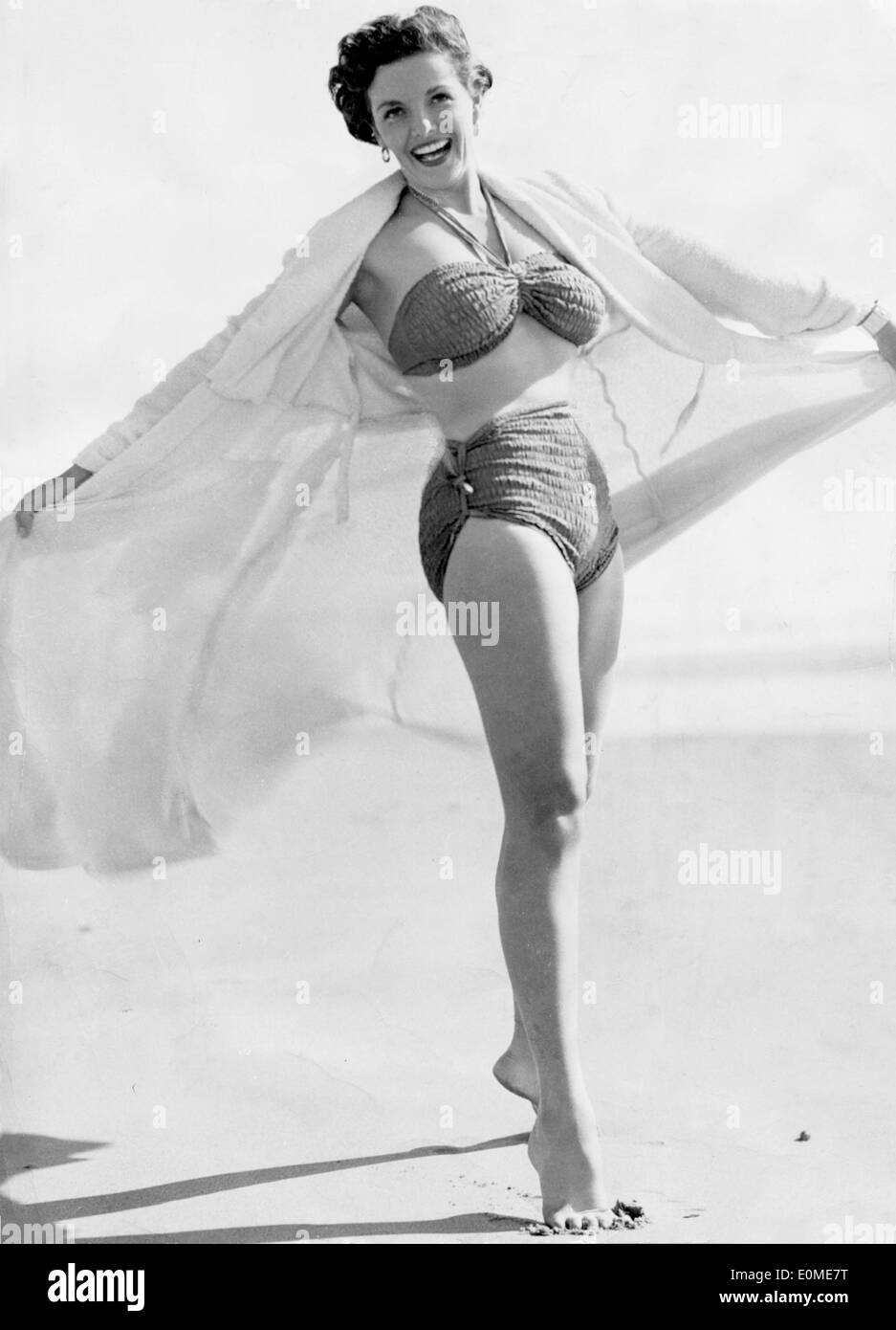 8b03acc59cc58 Actress Jane Russell on the beach during a charity tour - Stock Image