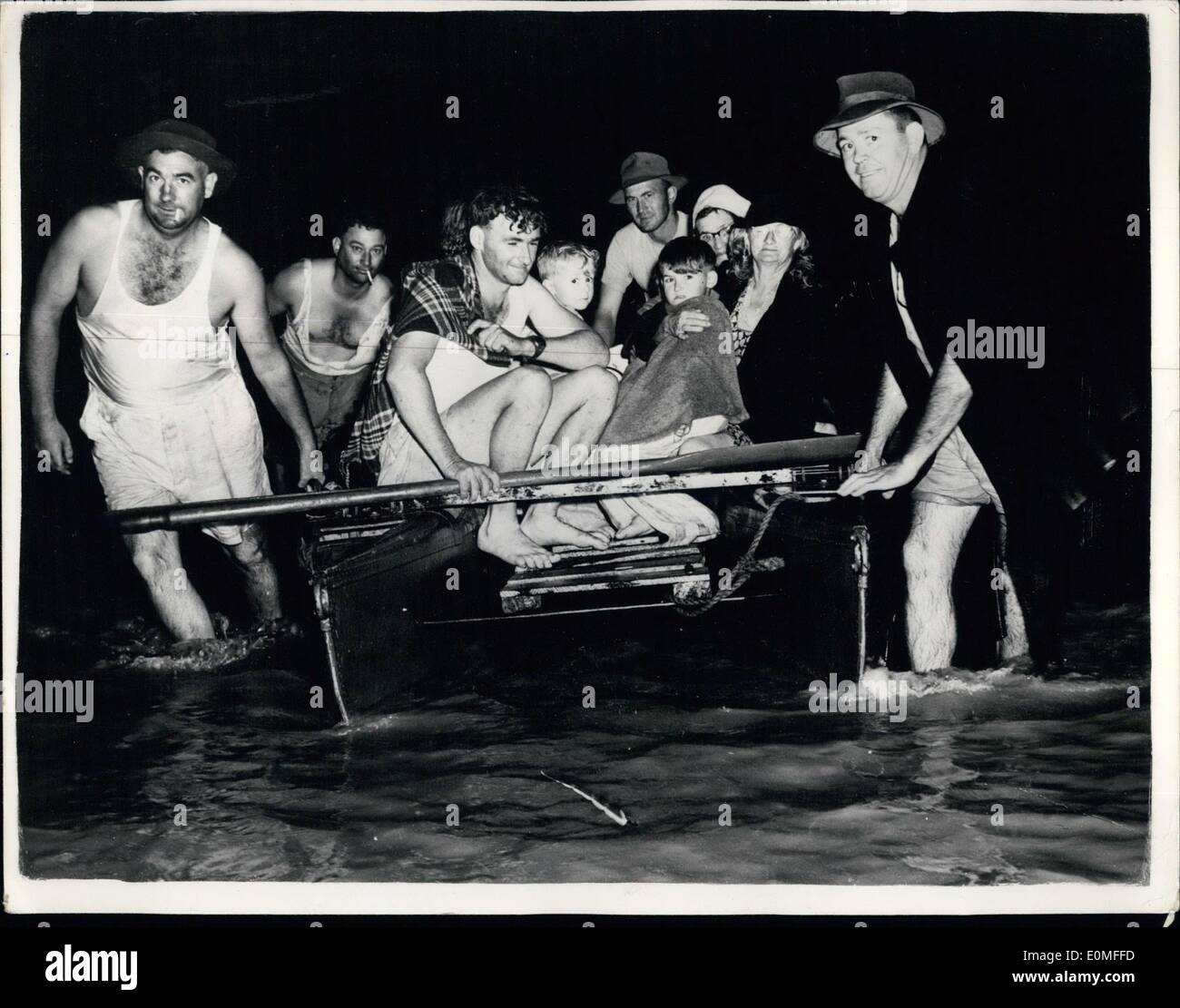 Mar. 03, 1955 - FOLLD HAVOC IN NEW SOUTH WALES. 100 DIE AND 50,000 REND RED HOMELESS. Photo shows Rescued after Stock Photo