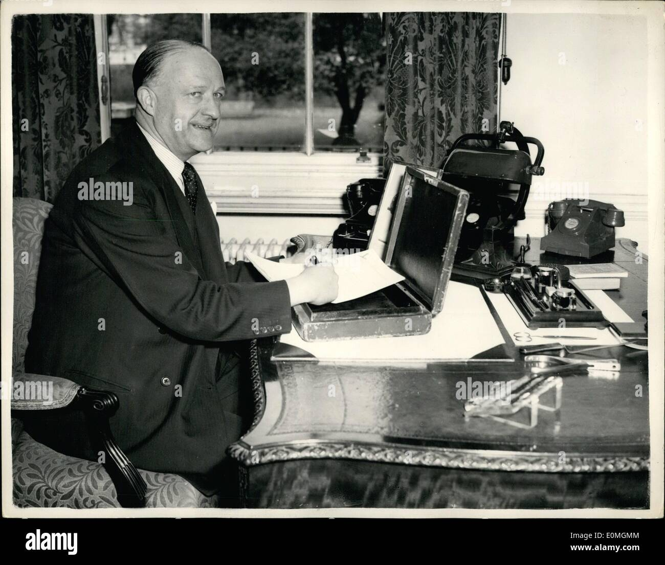 Apr. 04, 1955 - Not for publication until Tuesday - April 19th. 1955. chancellor of the exchequer prepares his budget Mr. R.A. butler at fl downing street. Bippa photo shows Mr. R.A. Butler the chancellor of the Exchequer - seen at his desk at his official residence - no. 11. downing street - with the famous budget box - as he prepares his budget. - Stock Image