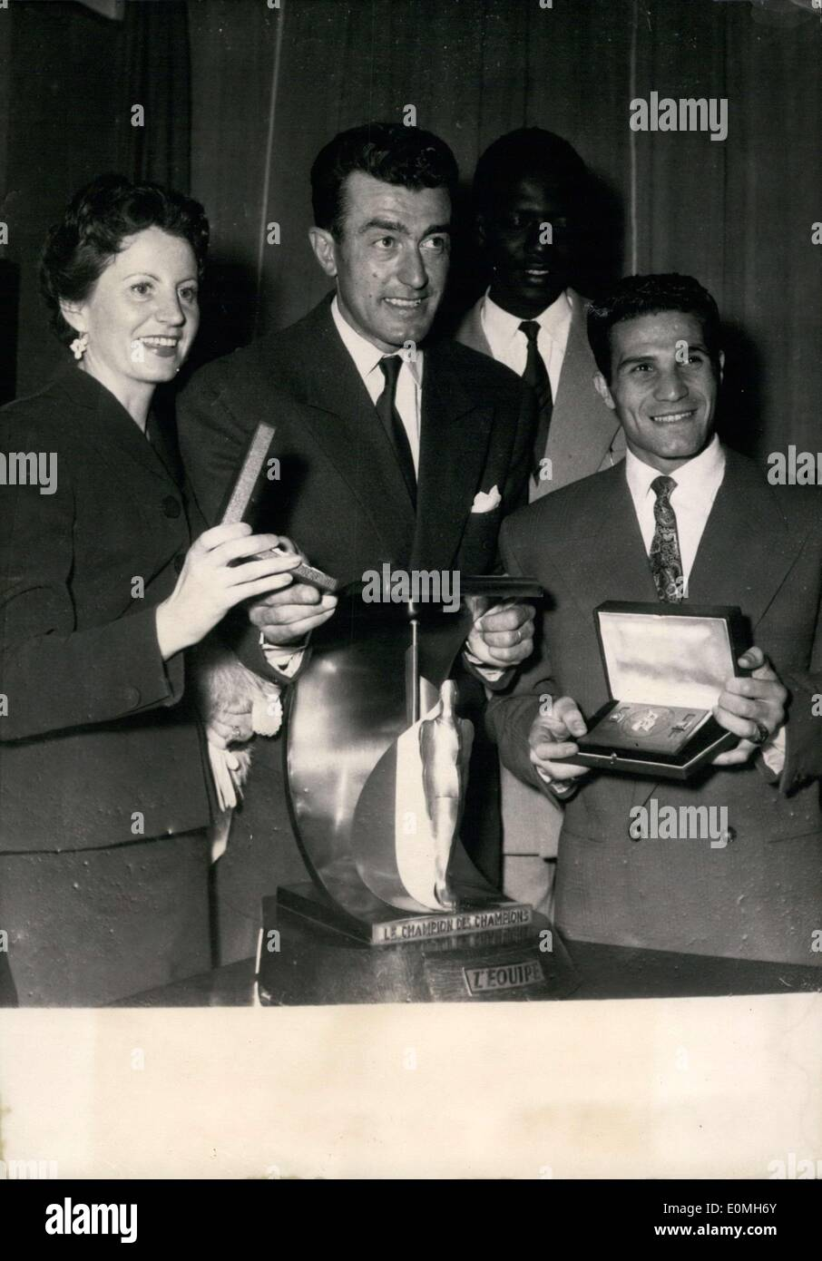 May 11, 1955 - ''The Champion of Champions'' title was given to cyclist Louison Bobet during a reception held in his honor. Bobet (center) is pictured here right after he received the trophy with his wife (left) and Robert Cohen (right). Thiam Papa Gallo stands behind the group. - Stock Image