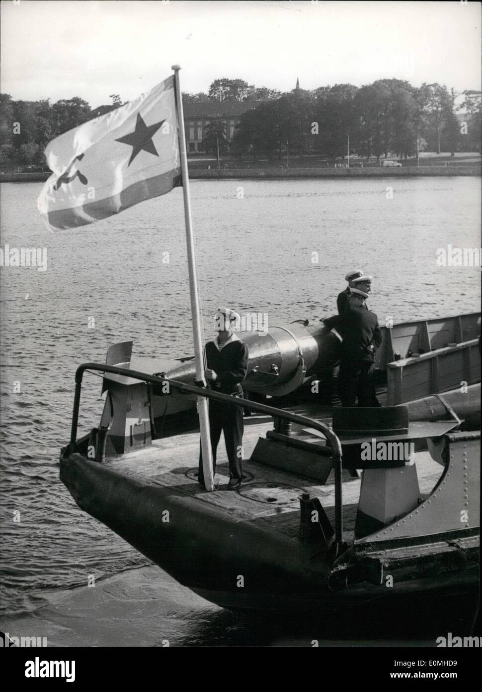 Jul. 07, 1955 - Lent-ships return from Russia to USA 14 ships, which had been lent to the Soviets by USA during World War II, were returned by the Soviets at Kiel/Germany. Our picture shows the hauling in of the Soviet-flag. - Stock Image