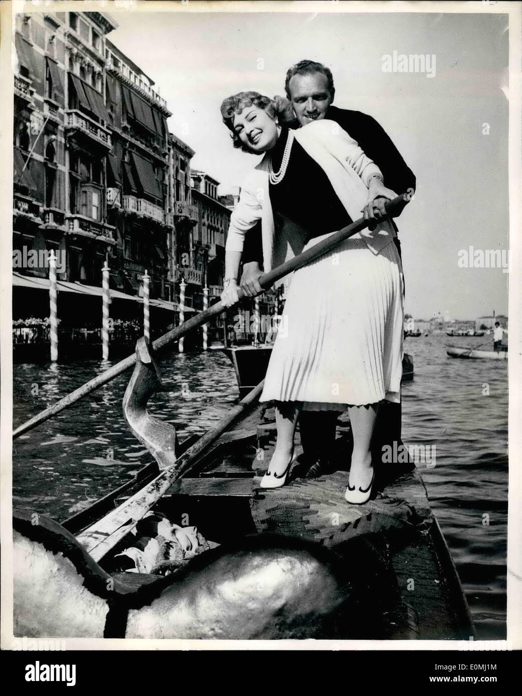 Jun. 06, 1955 - Italian Film Star Tries Her Hand On A Venetian Gondola: The Popular auburn- haired Italian film star Sylvana Pampanini. tries her hand at rowing a gondola on the Grand Canal at Venice- with a little assistance from the gondolier - who said she could join in his crew any time she wanted to. Sylvana was in Venice top see the world premiere of ''Summertime,'' which was filmed entirely in Venice. - Stock Image