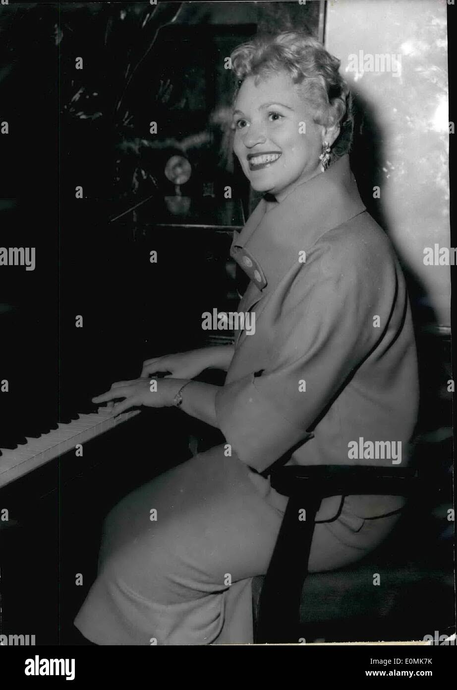 Jul. 07, 1955 - Judy Holliday in Paris; The famous American Screen star proves she is an accomplished pianist at a press reception held in a Champs-Elysees Club today. She is in Paris for a few days before going back to Hollywood where she will star in a new film ''Solid gold Cadillac' - Stock Image