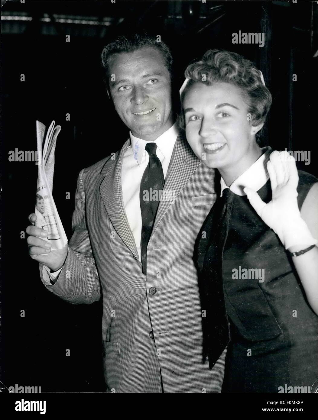 Jul. 07, 1955 - Richard Burton and Wife Go To The States.. Queen Mary Boat Train: Keystone Photo Shows:- Stage and film actor Richard Burton and his wife Sybil - seen when they left Waterloo station this morning on the S.S. Queen Mary Boat train for the United States. - Stock Image