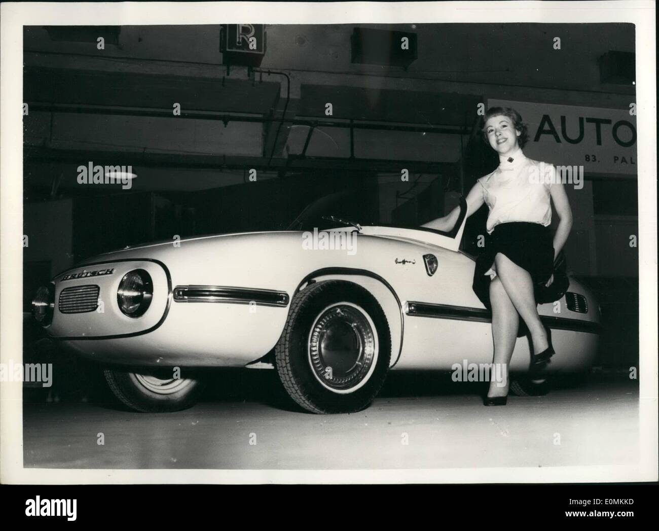 Nov. 11, 1955 - New German Designed Three Wheeler - Constructed In England At Cycle And Motor Cycle Show: Photo Shows Jill Hinkley a model - seated an the new Breutsch 300 Mk.1 - three wheeler - three seater car - which will be powered with a villagers 250 two stroke twin - with cursing speed of 50 m.p.h. at 60 - 65 m.p.g. priced at 98 inc; P.T. the car was designed originally in Stuttgart - and is to be made in England (Nottingham under licence) - Stock Image