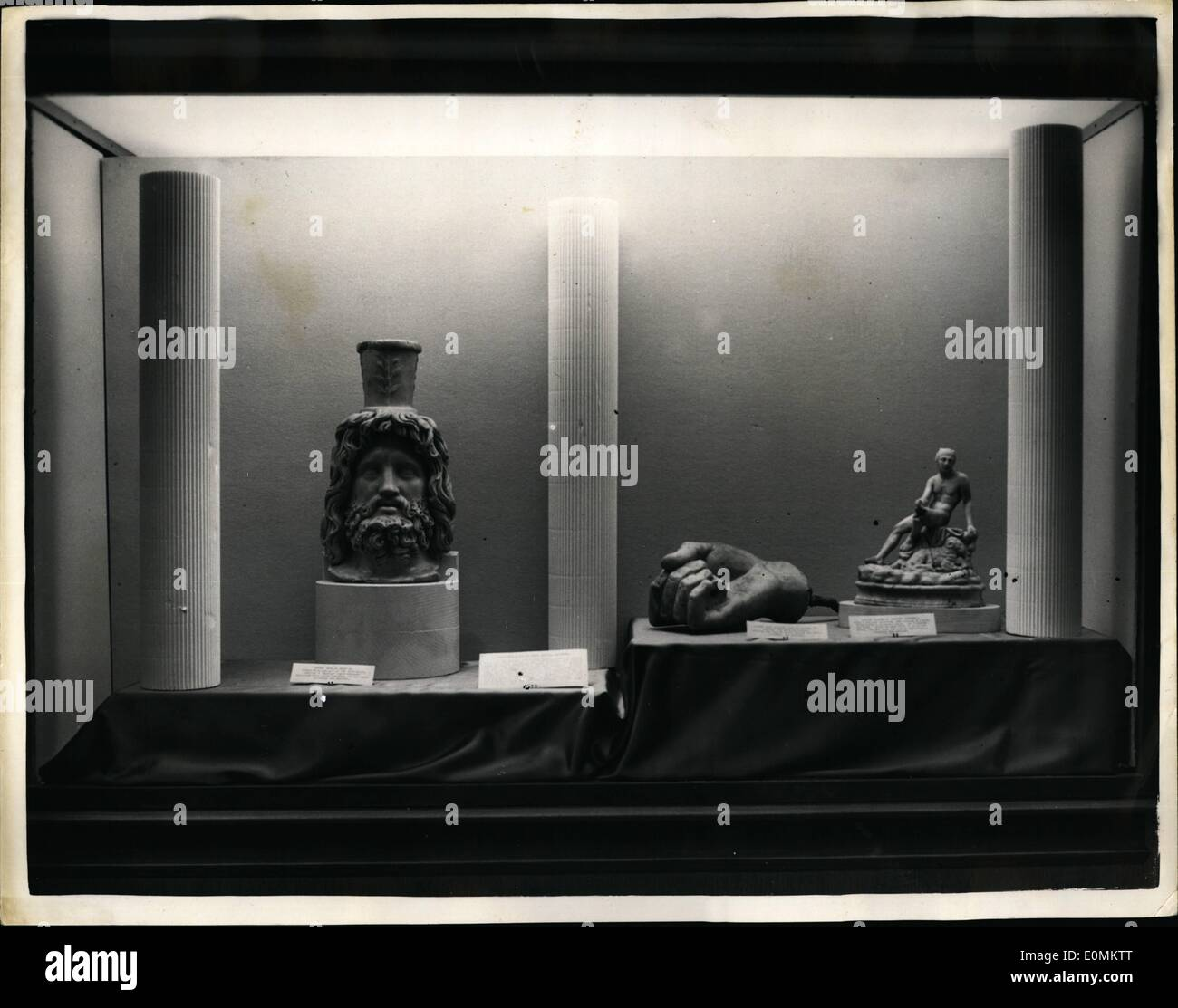 Oct. 10, 1955 - Archaeology Exhibition at Royal Exchange; An exhibition organized by the London and Middlesex Archaelogical Society to mark their centenary, was opened today at the Royal exchange by the Lord Mayor of London, Sir Saymour Howard. Photo Shows Sculpture found in the Roman Temple, Walbrook City, seen at the exhibition. On Left, Head of Serapis and on right figure of Mercury. - Stock Image