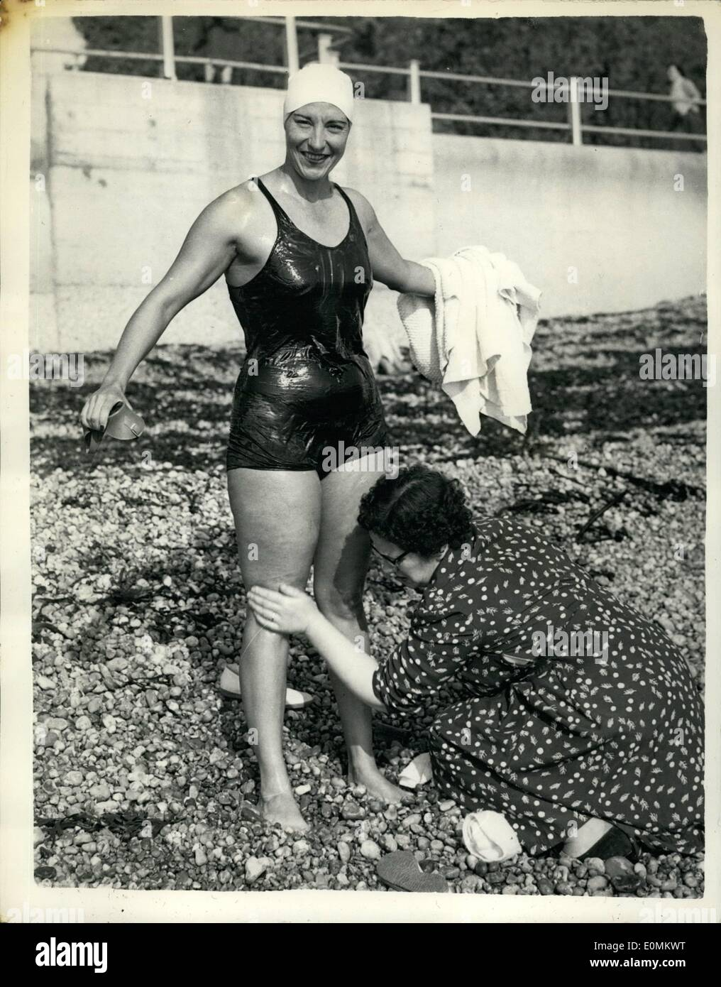 Oct. 10, 1955 - Florence Chadwick Tries Again For Channel ''Double'' Fourth Attempt This Year: Miss Florence Chadwick, the 35 year old Californian swimmer entered the water at St. Margaret's Bay, near Dover at 10-24 a.m. today in her attempt at a non-stop double crossing of the Channel. This is her fourth attempt this year. Her first aim is to beat the England - France record of 14 hrs. 6 min. set up six weeks ago by Bill Pickering of Bloxwich. Photo shows Miss Florence Chadwick is prepared for the swim at St. Margaret's Bay, today. - Stock Image