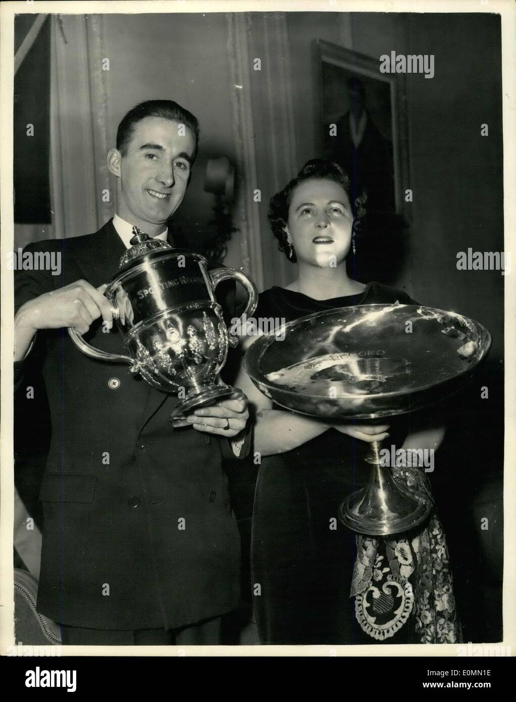 Dec. 28, 1955 - Gordon Pirie wins Awards: At the Savoy hotel this evening, Gordon Pirie was awarded the sporting Record's ''Sportsman of the year'' Trophy - whilst Miss Pat Smythe received the ''Sportswoman of the year Trophy''. Gordon Pirie was also awarded the B.B.C. Television Sports Personality of the year Sportsview Trophy. Picture shows: Gordon Pirie, holding the ''Sportsman of the year '' Trophy, whilst Pat Smythe holds her ''Sportswoman of the year'' Trophy - after the presentation at the Savoy Hotel this evening. - Stock Image