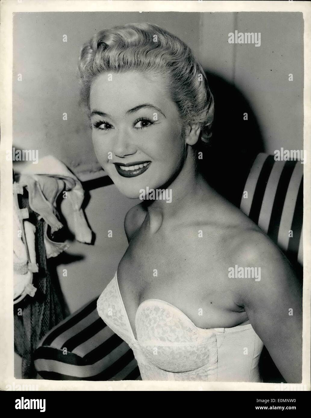 Apr. 04, 1956 - Susan Irvin takes over from Joy Nicholls, who is ill in ''The Pajama Game''; Because Joy Nicholls, the star of ''The Pajama Game'' at the Coliseum, has laryngitis, 21 year old Susan Irvin, who has been her stand in for 14 months, takes over the part today. Photo Shows Susan Irvin, seen in a happy mood in the star's dressing room, just before she went on stage for this afternoon's matinee. - Stock Image