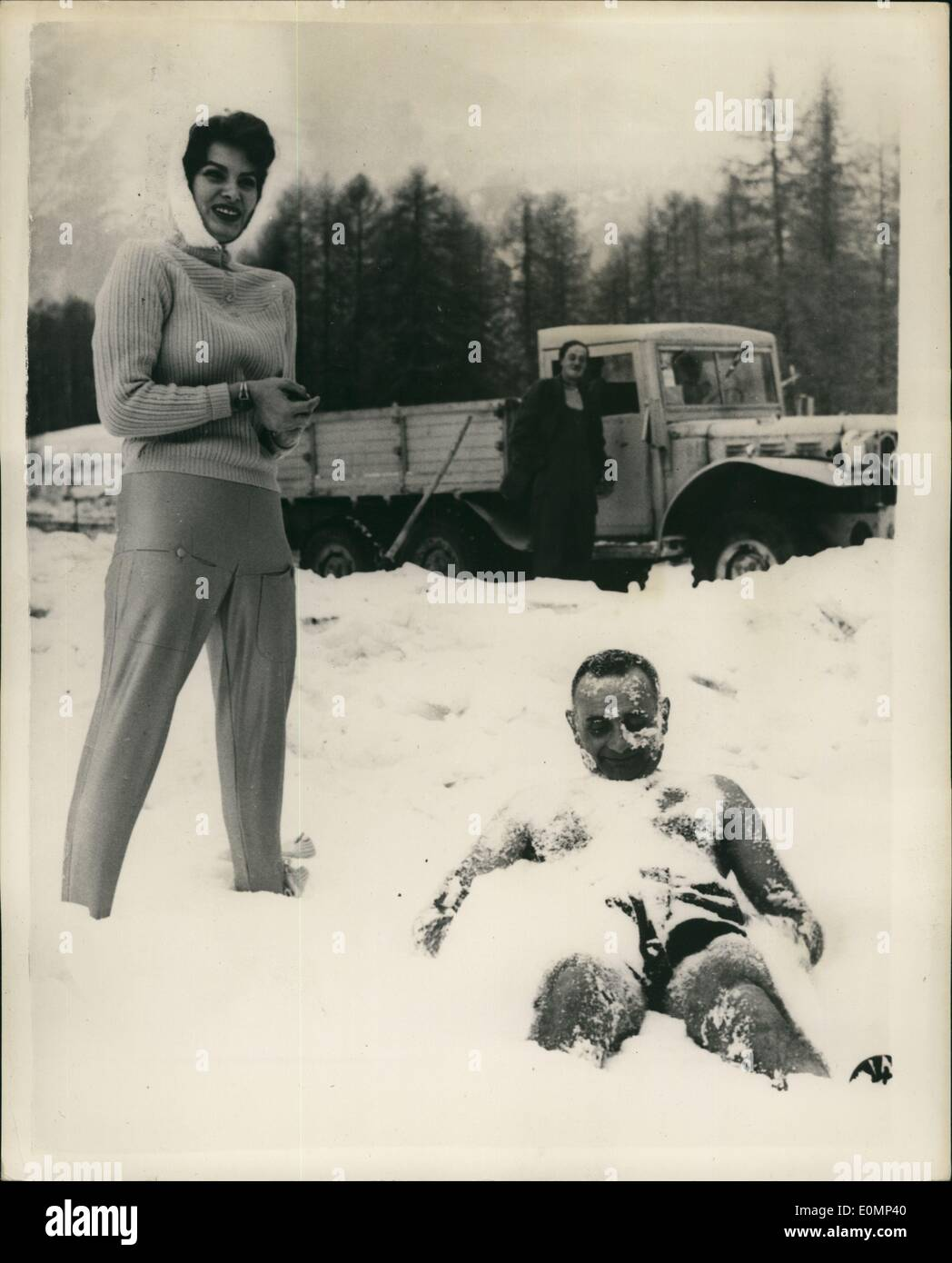 Feb. 02, 1956 - Sofia Loren Looks In At The Winter Olympics Matches A Friend Have A snow Bath: Popular Italian screen star Sofia Loren was one of the very popular visitors to the winter Olympic Gamest at Cortina d'Ampezze - and show is seen he as she looks on at man friend who enjoys a snow-bath in the ''too celd for me'' - says Befia. - Stock Image