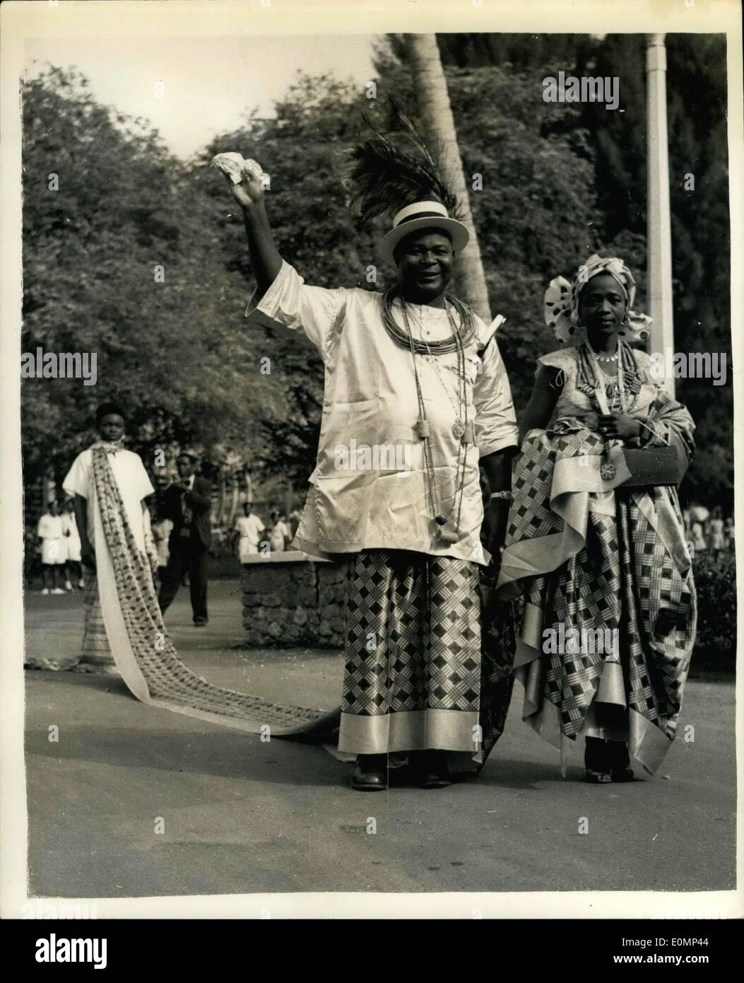 Feb. 02, 1956 - Royal Tour Of Nigeria: Nigerian V.I.P.'s Meet the Queen: Photo Shows Chief Festus Okotie-Eboh, Minister of Labour, arriving at the House of Representatives in Lagos, with his wife, Victoria . His servant followed bearing his 20-foot train, which he wears around his neck. - Stock Image