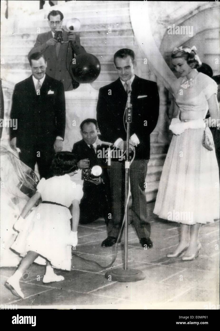 Apr. 04, 1956 - Monaco Wedding tomorrow: 6 year old Jacqueline Pasquier of Nantes curtsying before Grace Kelly and Prince Rainier at the Royal Palace this afternoon. - Stock Image