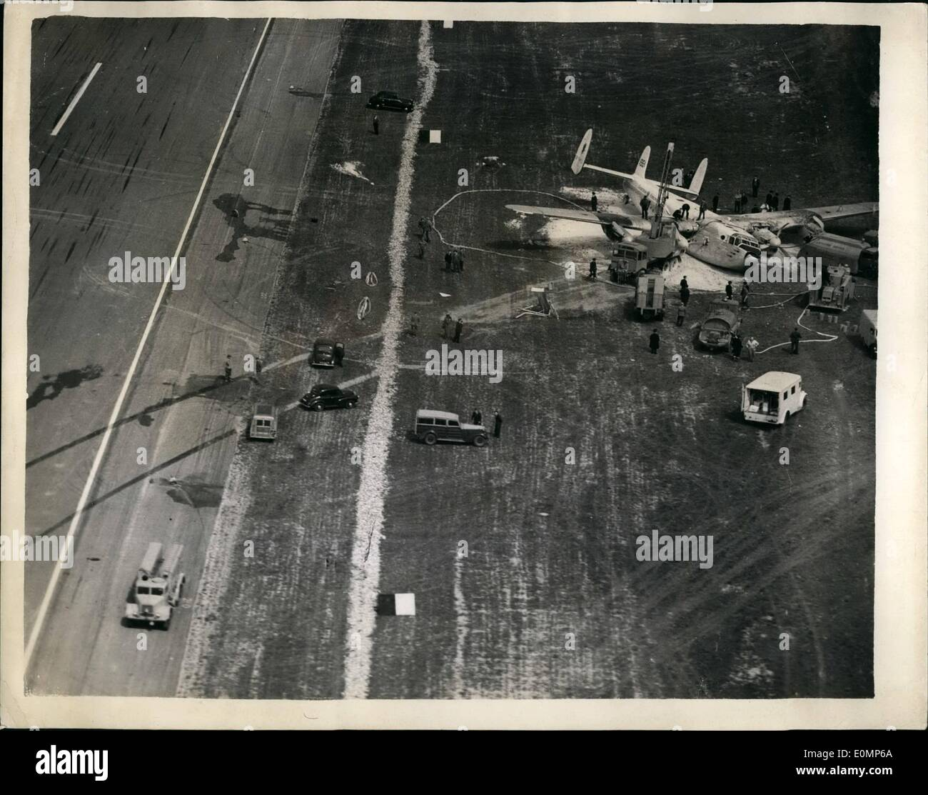 Apr. 04, 1956 - Two die in airliner crash.: An R.A>F. man and a little girl were killed - and four injured when an airliner with 54 people aboard-crashed at Stansted Airport, Essex today. The four-engined York airliner was taking off with families and Servicemen for Cypm's and Irak when it plunged off the runway. Women with babies in their arms scrambled out as patrol gushed from the plane's shattered tanks. Dense petrol fumes turned the insed of the plane into a gas chamber. Firemen pumped oxygen into the wreckage to keep the trapped people alive - Stock Image