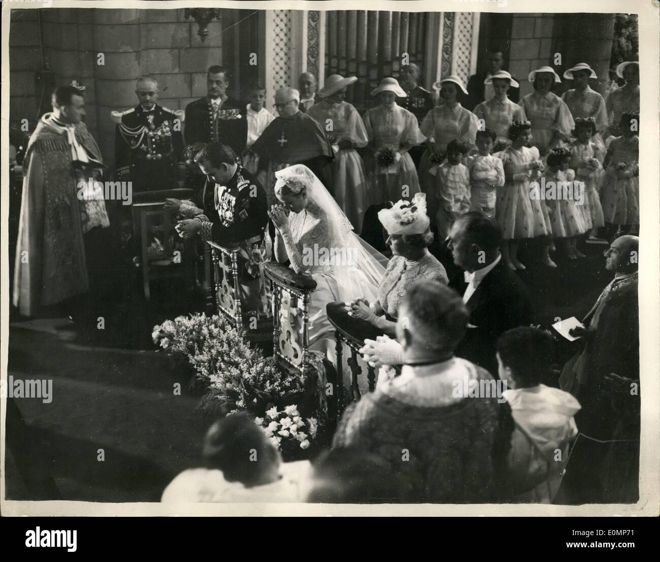 Apr. 04, 1956 - Prince Rainier Grace Kelly The Bride And Bridegroom Pray: Photo Shows Prince Rainier and Grace Kelly pray - during the wedding ceremony in Monaco Cathedral morning. The Bride Samainds and guests can be seen surrounding them. - Stock Image