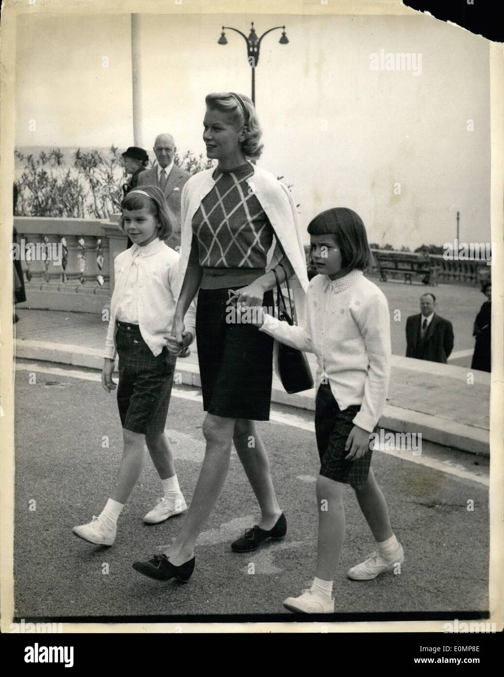 Apr. 04, 1956 - Prepsring For The Grace Kelly -- Prince Rainier Wedding. Photo Shows Grace Kelly's sister Peggy (Mrs. George Davis) seen with Meg and Mary Lee -- at Monaco where preparation are going ahead for the wedding of Grace Kelly and Prince Ranier. Peggy will be Matron-of-hour and her children will be bridal attendants. - Stock Image