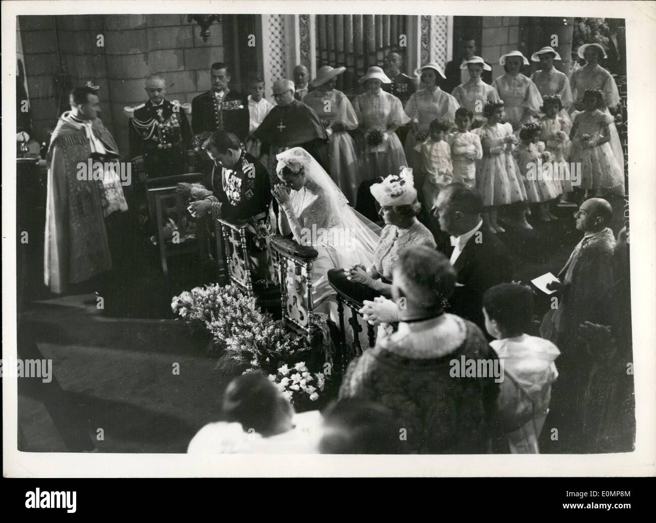 Apr. 04, 1956 - Prince Rainer weds Grace Kelly......The Bride and Bridegroom Pray. Photo Shows Prince Rainier and Grace Kelly pray - during the wedding ceremony in Monaco cathedral this morning. The bridesmaids and guests can be seen surrounding them. - Stock Image