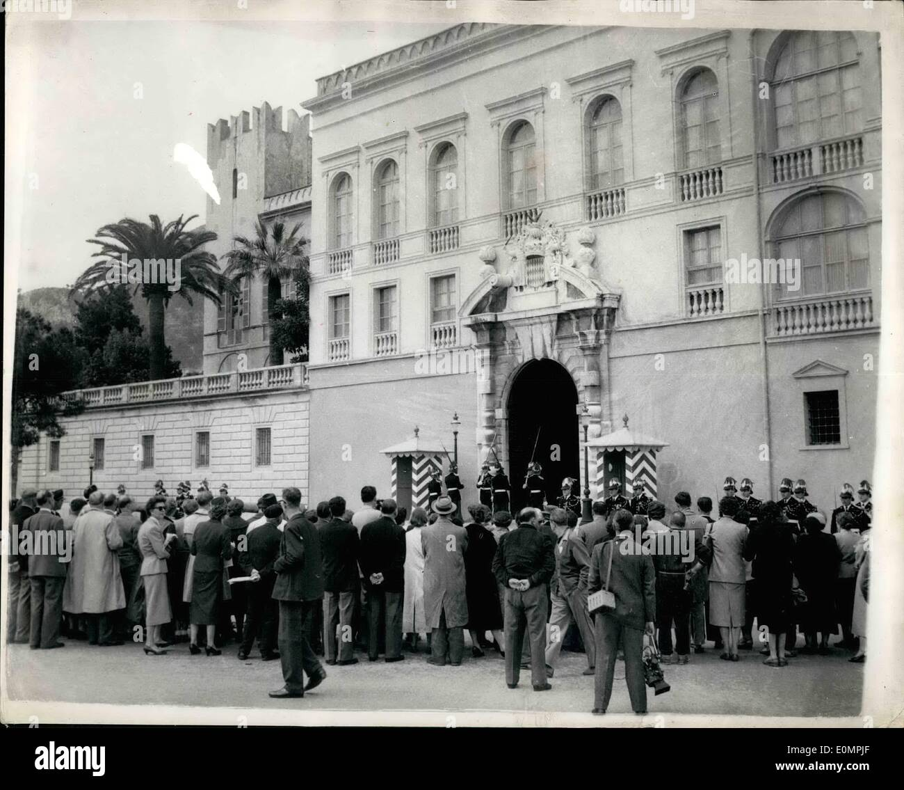 Apr. 13, 1956 - 13-4-56 All set for the Grace Kelly. Prince Ranier wedding. Crowds outside the Royal Palace, Monaco. Keystone Wire Photo Shows: The scene as onlookers watch the changing of the guard ceremony outside the Royal Palace in Monaco today. There were repeated calls of Let's see Princess Grace but she did not appear on the balcony as hoped. The final details are now almost complete for the wedding next week. - Stock Image