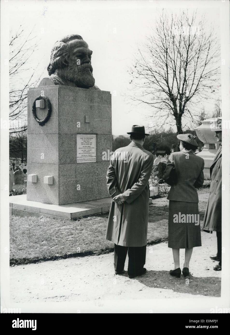 Apr. 16, 1956 - Karl Marx statue defaced-and cleaned: The 12ft. high Karl Marx memorial in Highgate Cemetery which was daubed with white paint during the night-has been cleaned. The incident is believed to be in protest of the forthcoming visit to London of the Soviet Leaders. Photo shows Two officials look at the statue after it had been cleaned today. - Stock Image
