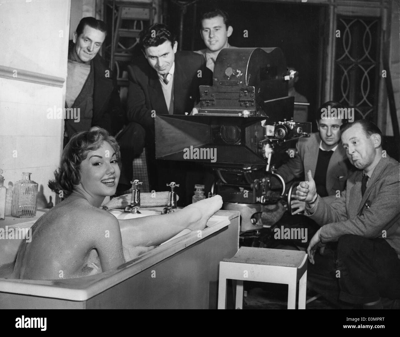 Feb. 8, 1956 - Actress MYLENE DEMONGEOT takes a bubble bath surrounded by cameramen and crew on set of the film, 'It's a Great Life,' at Shepperton Studios. - Stock Image