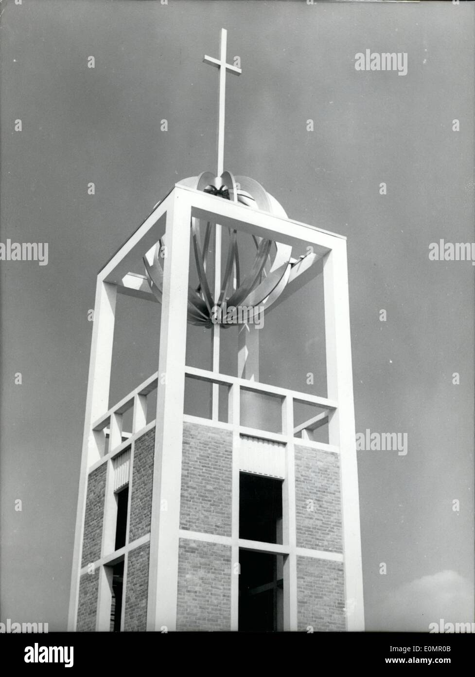 May 05, 1956 - Of Symbolical meaning : Is the cross over the globe on the new protestant church of the Zion-community in Bremen. The top of the Tower is 12m high and the symbol is made by light metal. The modern tower of the church has a high of 32m. - Stock Image