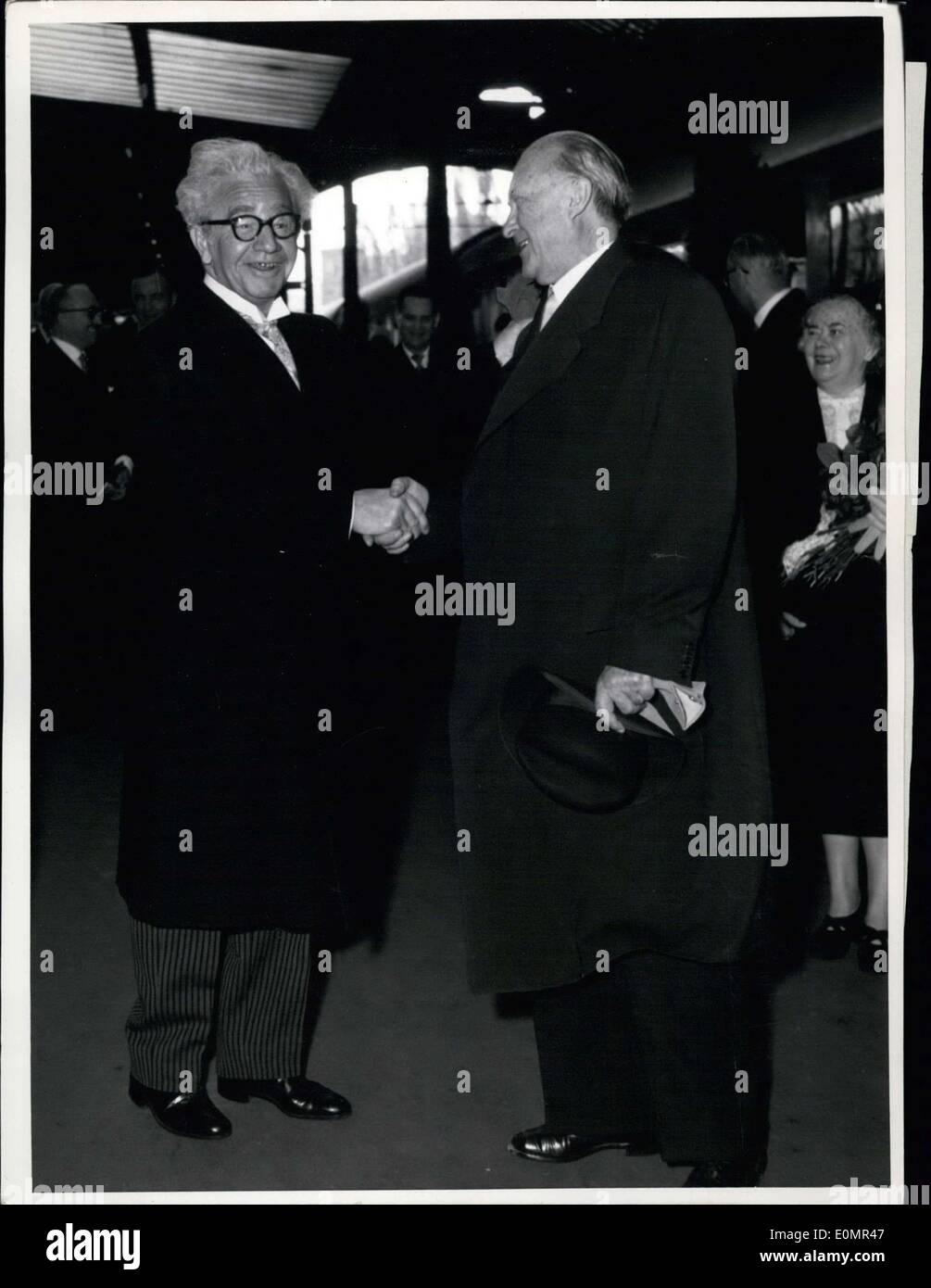 May 07, 1956 - Icelandic state-visit in Germany.. On Monday mid-morning Icelandic Prime Minister Olafur Thors and Icelandic Foreign Minister Dr. Kristinn Gudmundsson arrived at the main station in Bonn and were greeted by Chancellor Dr. Adenauer. The Icelandic guests will lead talks in Bonn during their four day stay in the country, as well as visit electric and steel plants in the Ruhr region and a winery in R?desheim. Pictured: At Bonn Station: Prime Minister Thors and Chancellor Dr. Adenauer. - Stock Image