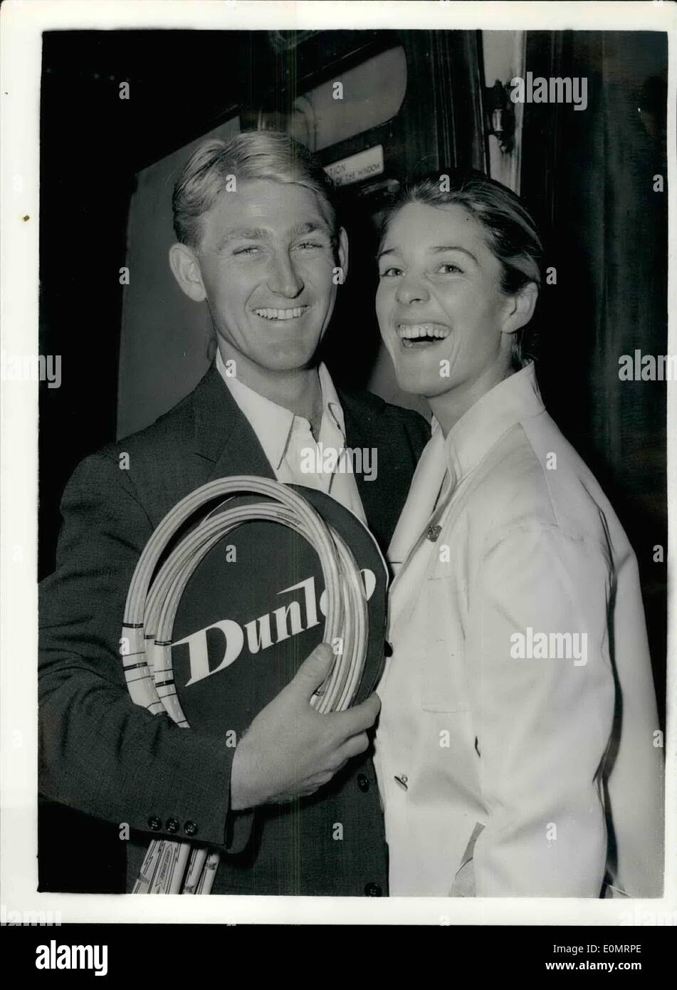 Aug. 08, 1956 - Australian tennis star leaves for the states. Wimbledon Champion for American Tournament.: Australia tennis star Lew Hoad - winner of the Singles Championship at Wimbledon - left Waterloo this afternoon for the United States to take part in the American championships. he was accompanied by his wife. Photo shows Mr. and Mrs. Lew Hoad at Waterloo station this afternoon. - Stock Image