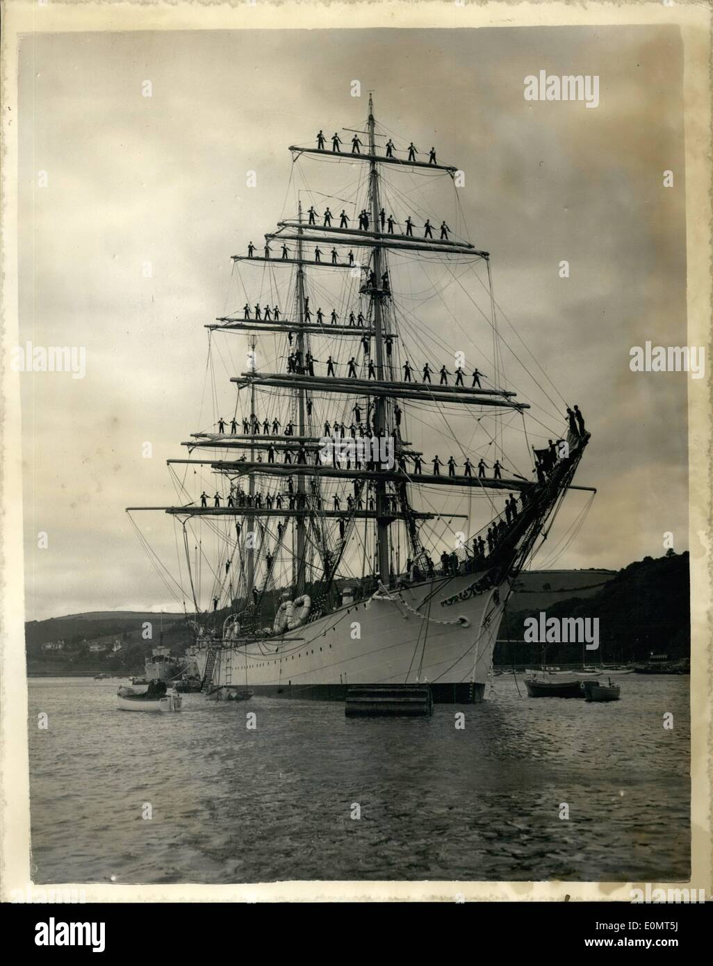 Jun. 06, 1956 - Portuguese sailing barque in the River Dart. Three cheers for the Mayor. The 3,000 ton Portuguese Sailing barque Sagres arrived in the River Dart yesterday. in readiness for the training ship race back to Lisbon. The picturesque vessel is under the command of Capt. L. Dentinho of the Portuguese Navy. Keystone Photo Shows: - The Sagres in the River Dart. as her yardarms are manned by the crew. giving three rousing cheers for the Mayor of Dartmouth. JSS/Keystone. - Stock Image