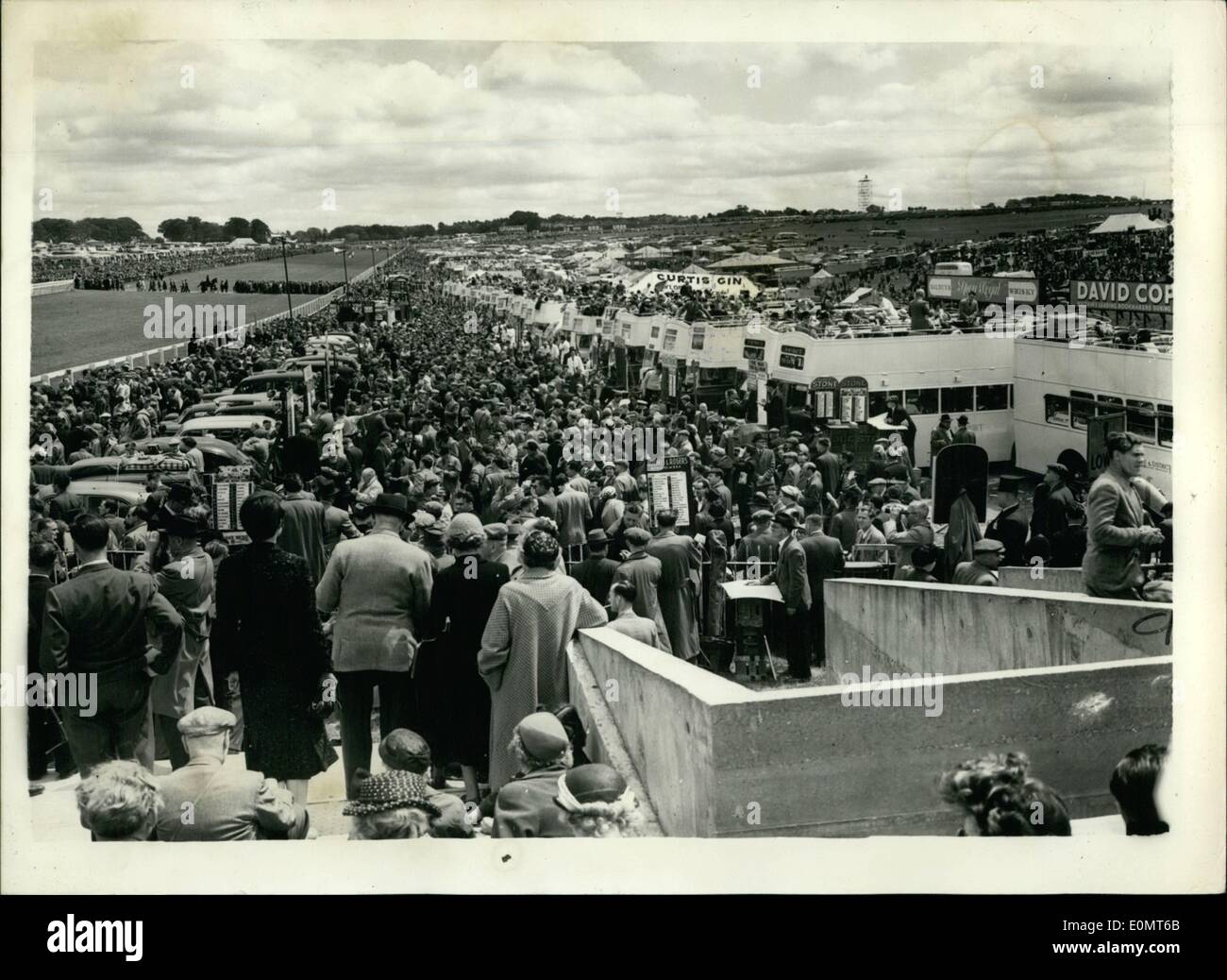 Jun. 06, 1956 - Derby Day At Epsom. General View Of The Crowds: Phot Shows General view showing part of the west crowd - with the bus and coach grandstands - at Epsom this afternoon. - Stock Image