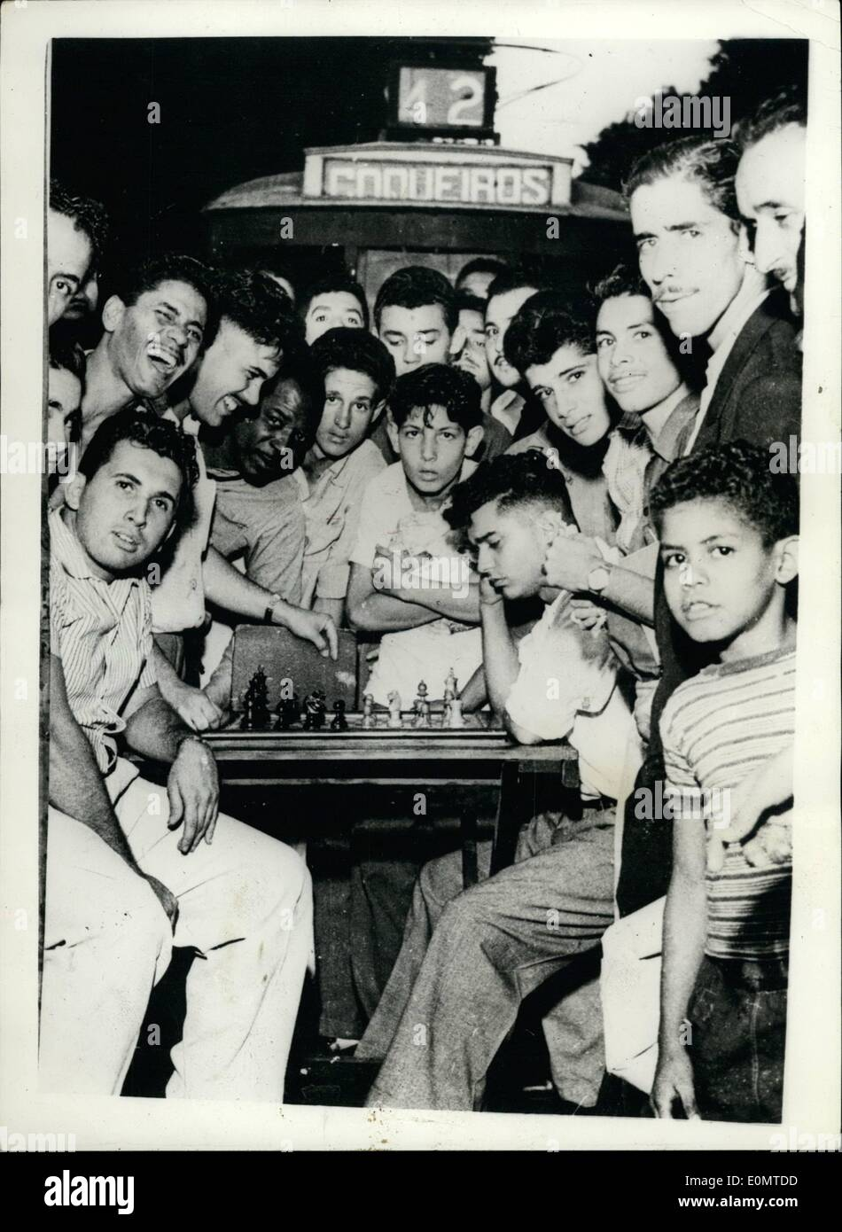 Jun. 06, 1956 - Students Demonstrate Against Fares Rise In Rio.. Play Chess On The Tramlines.. In an effort to prevent a 100 p.c. increase in tram fares in Rio d Janiero, Brazil - students from Universities recently organised a full scale demonstration - in which they stopped the trams by 'camping' on the lines.. To pass away the time they played games of chess - table tennis etc.. keystone Photo Shows:- The students seen during their game of chess - on the tramway lines in Rio - Stock Image