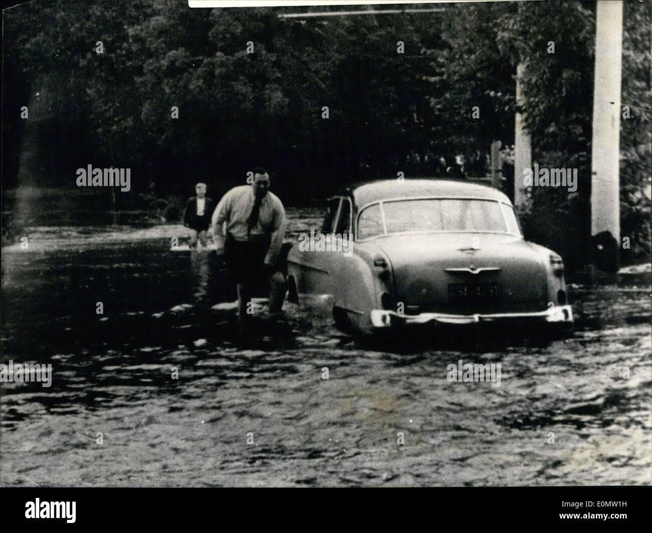 Jul. 07, 1956 - 25 millions DM is the injury through the high water only in the eastern part of Westfalen/Germany. Till yesterday night it has rained all the time for 60 hours. Photo shows a car driver was stopped by the high floods near Porta Westfalica/Germany. - Stock Image