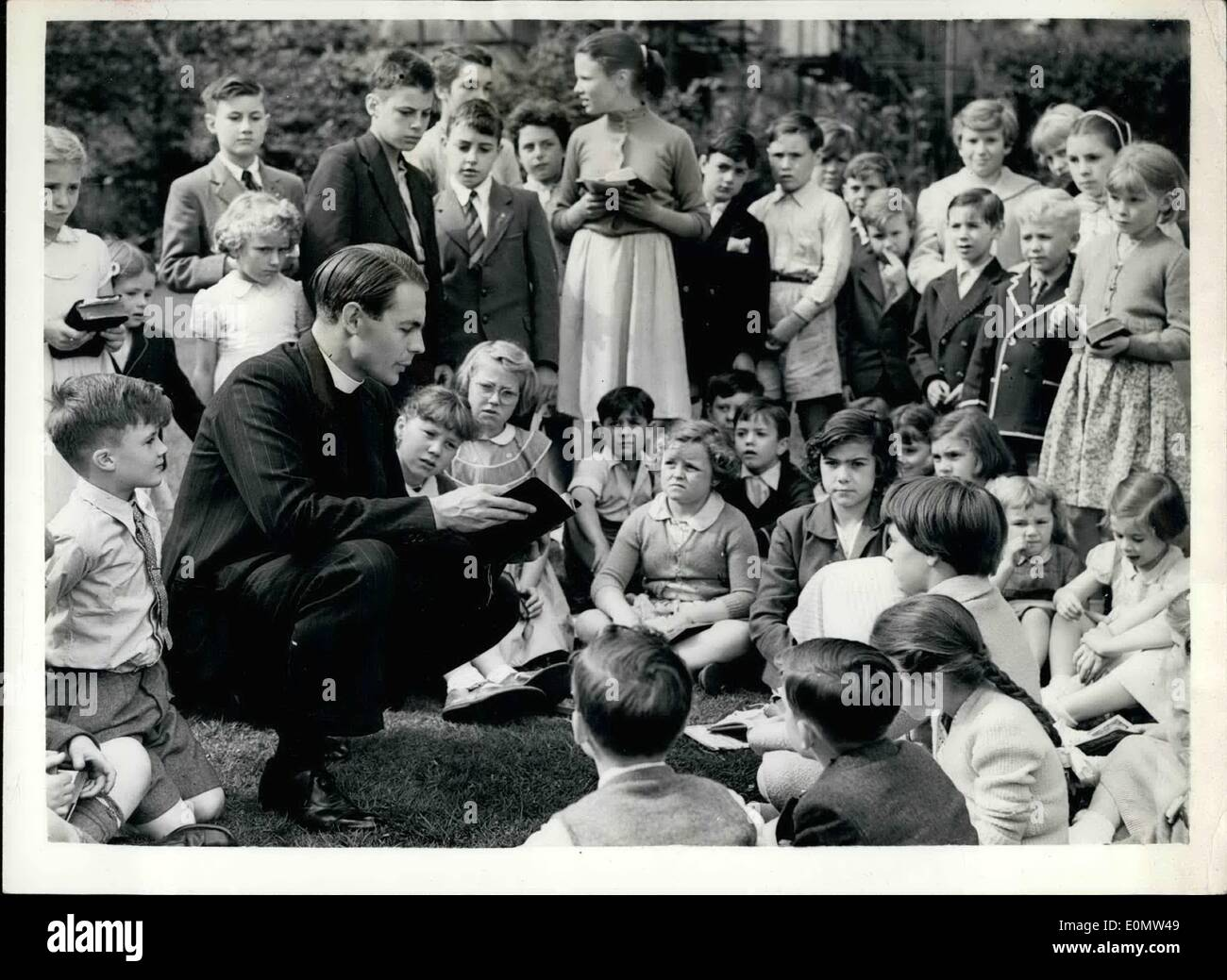 Jul. 07, 1956 - England's new parson-batsman takes his bible class.: The Rev. David Stuart Sheppard, curate of St. Mar's church, Islington, was yesterday chosen to play for England against Australia in the fourth test match at the Old Trafford on Thursday. He was told the news when he was taking his normal Sunday school class yesterday. Photo shows:- The Rev. David Sheppard, who has been chosen to play for England against Australia in the fourth test seen taking his bible class yesterday. - Stock Image
