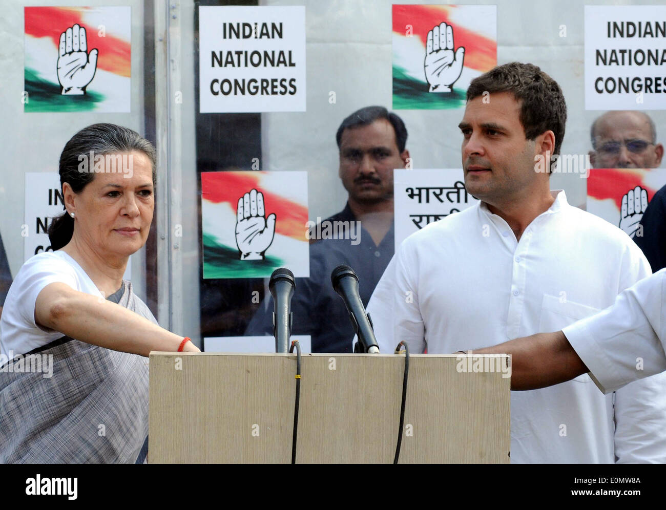 New Delhi, India. 16th May, 2014. Vice President of Indian National Congress party Rahul Gandhi (R) and his mother and party chief Sonia Gandhi address the media outside the party headquarters in New Delhi, India, on May 16, 2014. Rahul Gandhi Friday accepted responsibility for the ruling Congress party's worst ever defeat in India's general elections, as his mother and party chief Sonia Gandhi congratulated the main opposition Bharatiya Janata Party (BJP) on its landslide victory. Credit:  Partha Sarkar/Xinhua/Alamy Live News - Stock Image