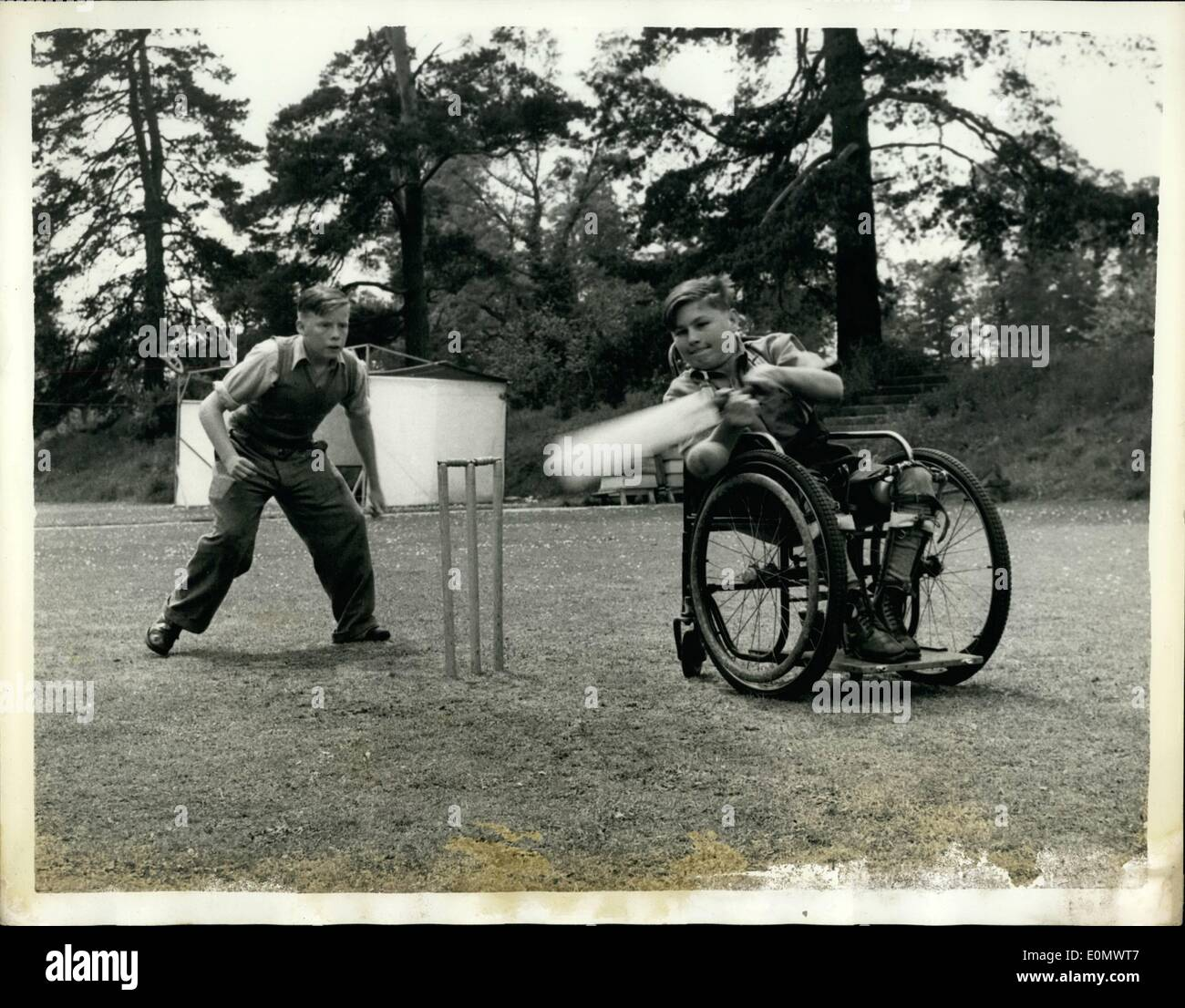 Jul. 07, 1956 - Cricket - From Wheel Chairs And Crutches: Every fine afternoon the lawns of Hinwick Hall, Beds, - Stock Image