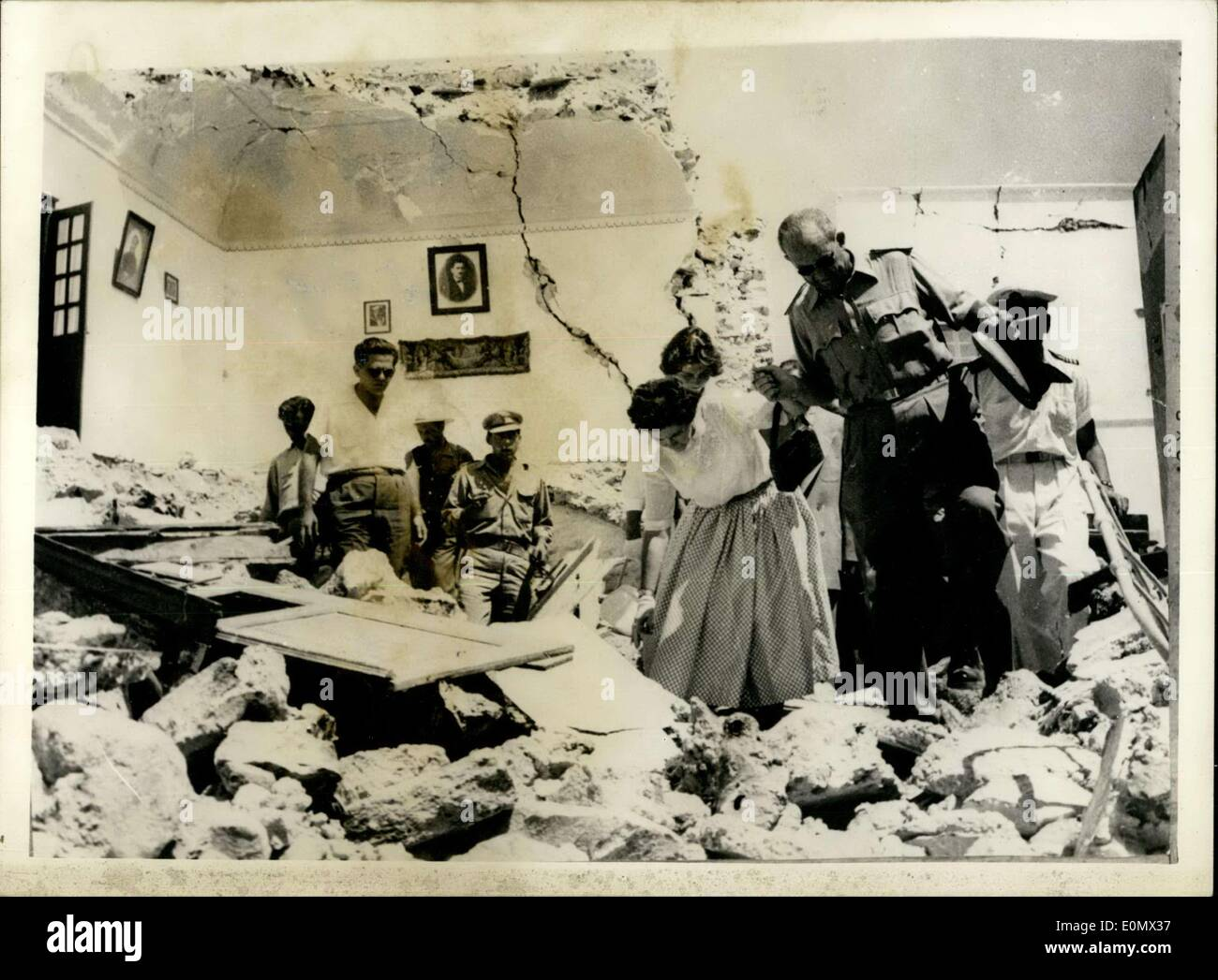Jul. 16, 1956 - King and Queen of Greece visit Earthquake-hit islands.: Photo shows King Paul of Greece assists Stock Photo