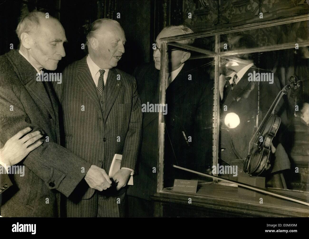 Oct. 10, 1956 - Mozart in Paris' exhibition opens at National Library: An exhibition entitled 'Mozart in Paris' (receiving the period when the young composer stayed and worked in Paris) opened at the Paris National Library this morning. Photo shows M. Paul Leon, deputising for the Minister of national Education (left) and Herr Vollburger, Austrian Ambassador to Paris examine the violin in which belong to young Mozart ( from the collections of Salzburg Theatre) - Stock Image