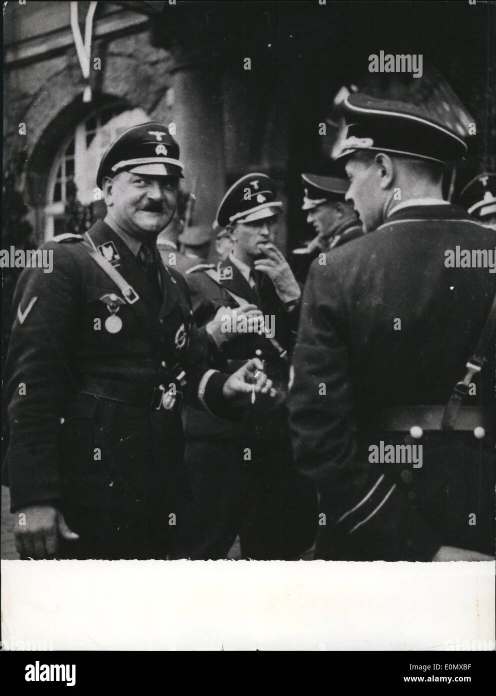 Aug. 08, 1956 - 22 Years after the Roehm-rist accusation against Sop Dietrich:The 64 Years old Sop Dietrich who left the Lanisberg-prison a short times ago is accused by the Munich court to have had informed the six leading Re chm-riots about Hitler's decision to shoot and Districh should also have given the order to shoot them. Photo Shows Sop Dietrich (left) as SS-Obergruppen-leader in 1938. - Stock Image