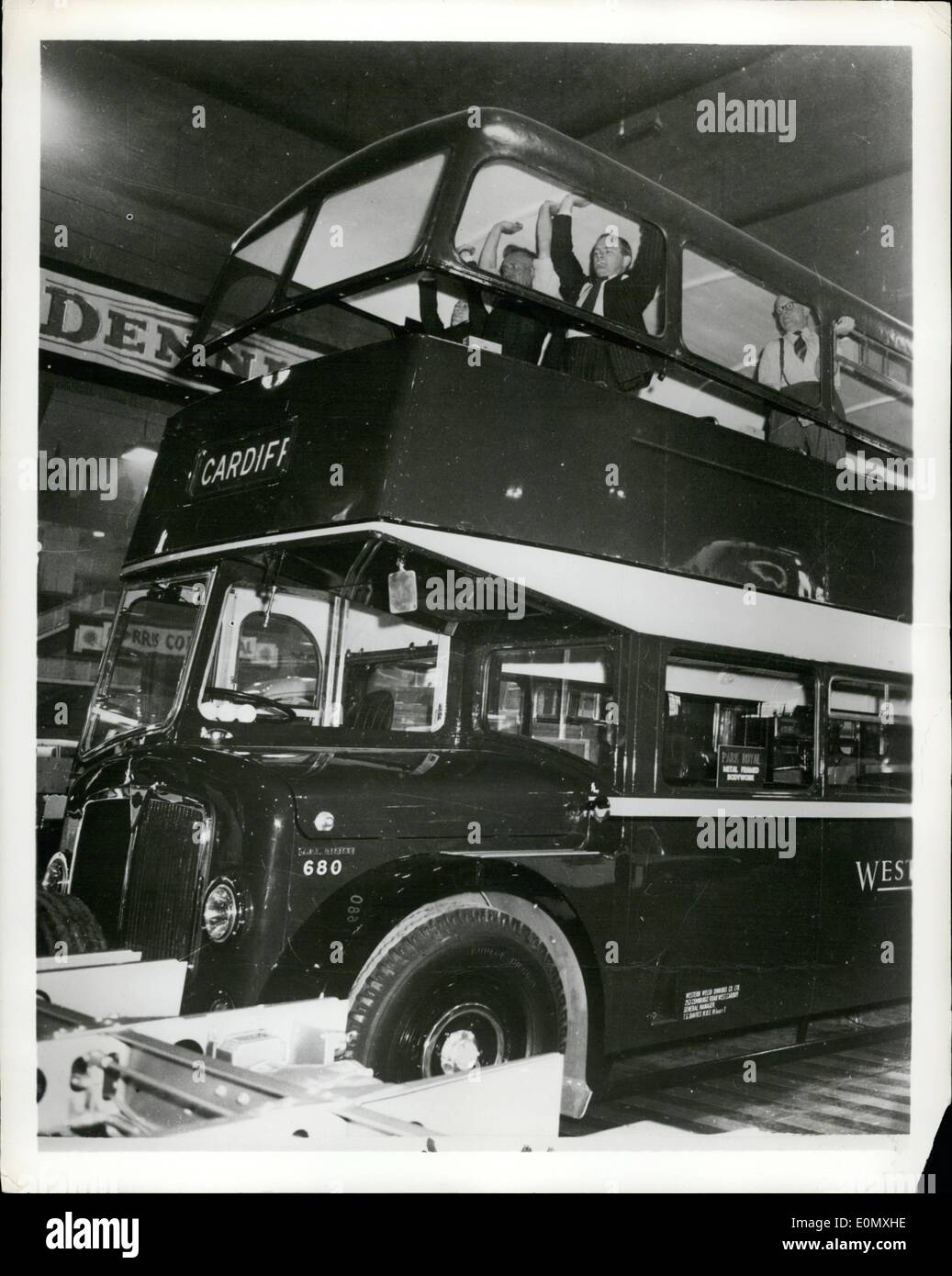 Oct. 10, 1956 - Bus ''Blows'' its top: A double Decker bus with a completely detachable plastic reinforced fiber glass roof, giving protection from bad weather and allowing the enjoyment of good, was a feature of a recent show of commercial vehicles in London and indicative of a growing British trend towards the use of plastics for lightweight body construction. Britain's exports of commercial vehicles for the first half of this year were valued at 40 million. Picture shows four men demonstrate the ease with which a bus can ''blow'' its top. Manufacturers of roof: Park Royal Vehicle Ltd - Stock Image