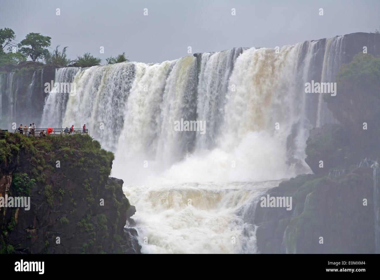 People on San Martin Island overlooking San Martin Waterfalls, Iguazu National Park, Argentina - Stock Image